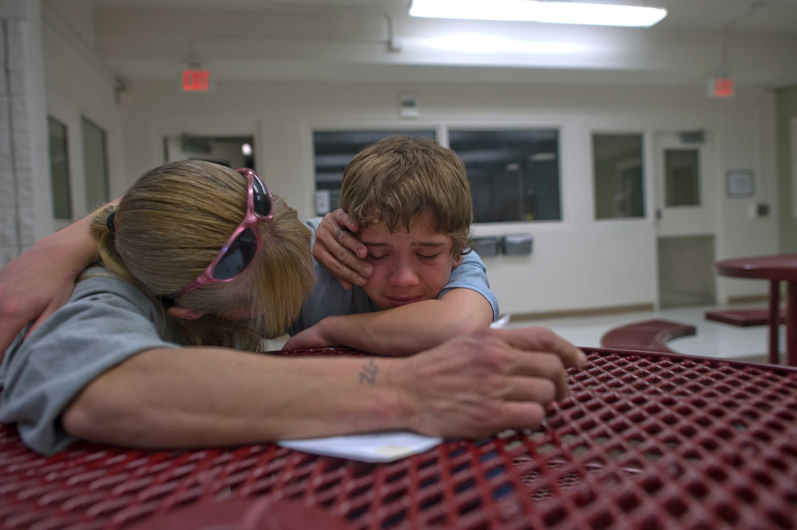 Vinny's mother Eve comforts him during visitation at the detention center.