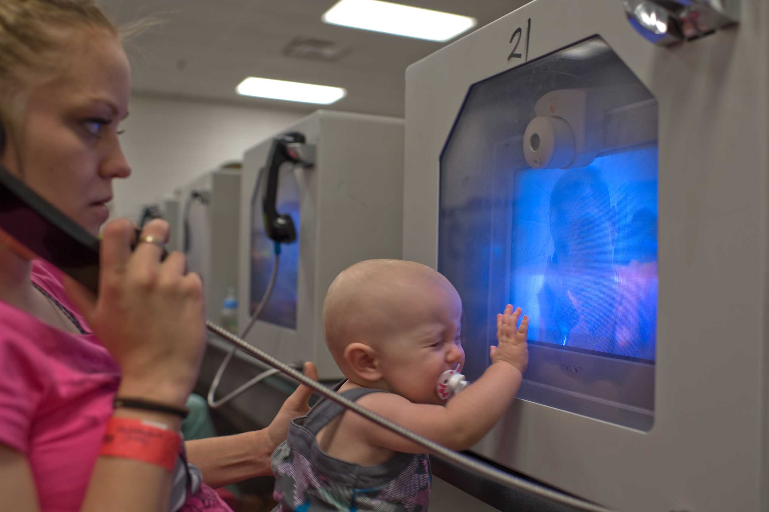 Felicia and their 10-month-old daughter Lily see David through video visitation.