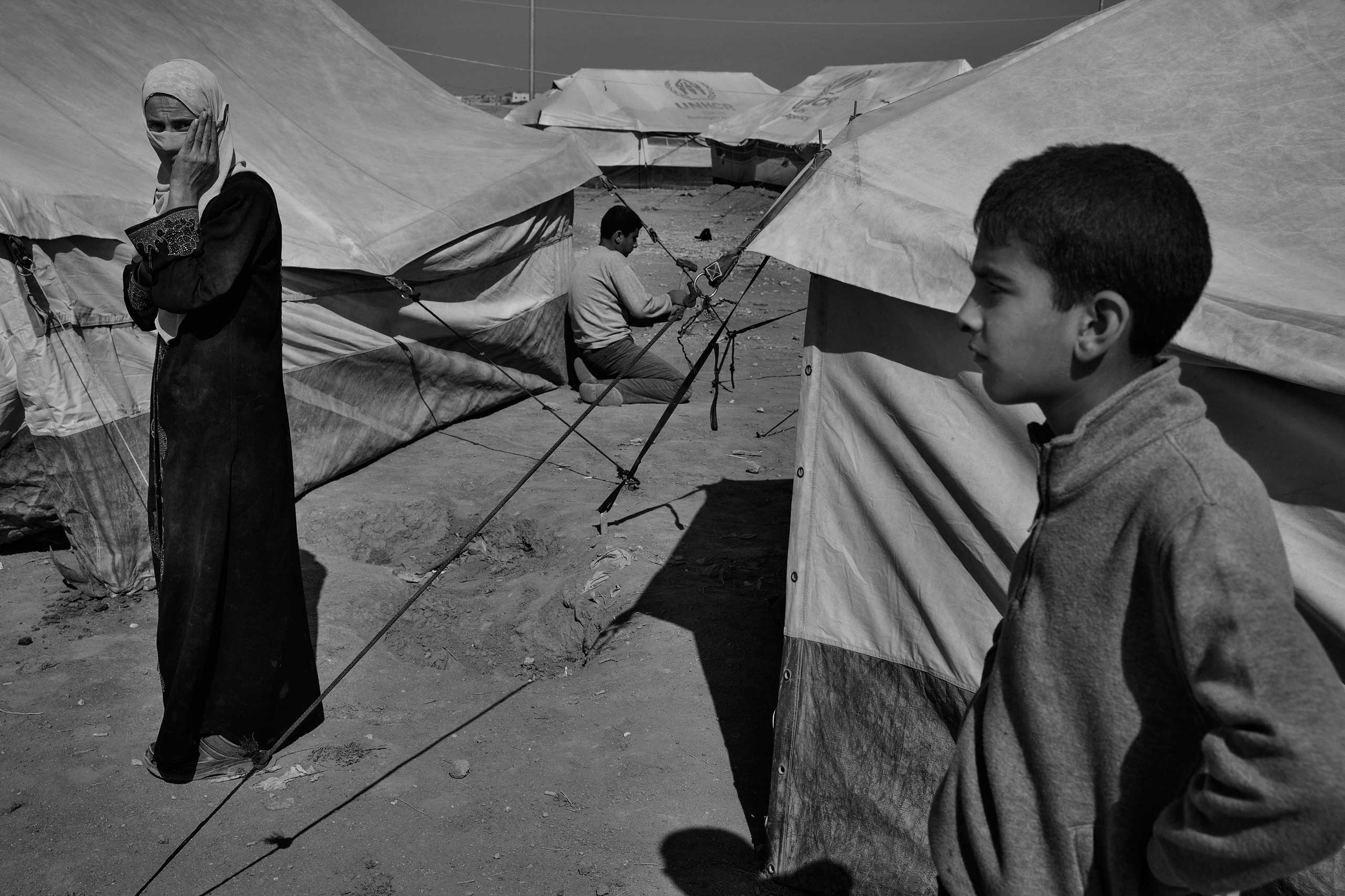 December 2013. Za'atari refugee camp, Jordan. New arrivals from Syria setting up tents supplied by the United Nations High Commissioner for Refugees.