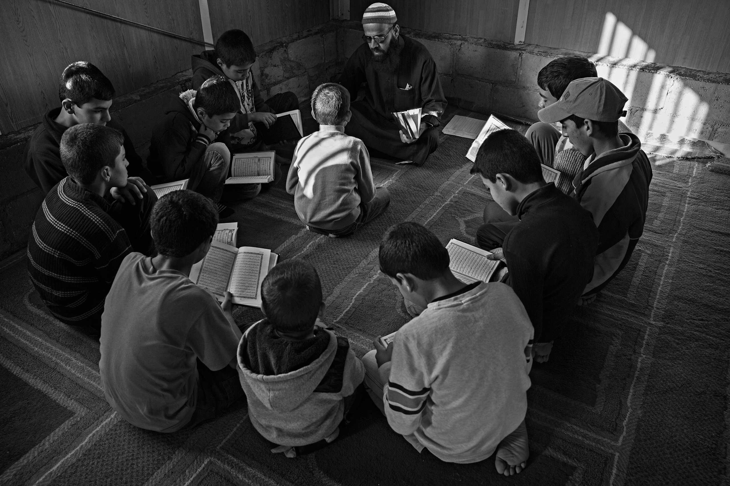 December 2013. Za'atari refugee camp, Jordan. Young boys learning the Koran during daily classes in a mosque.