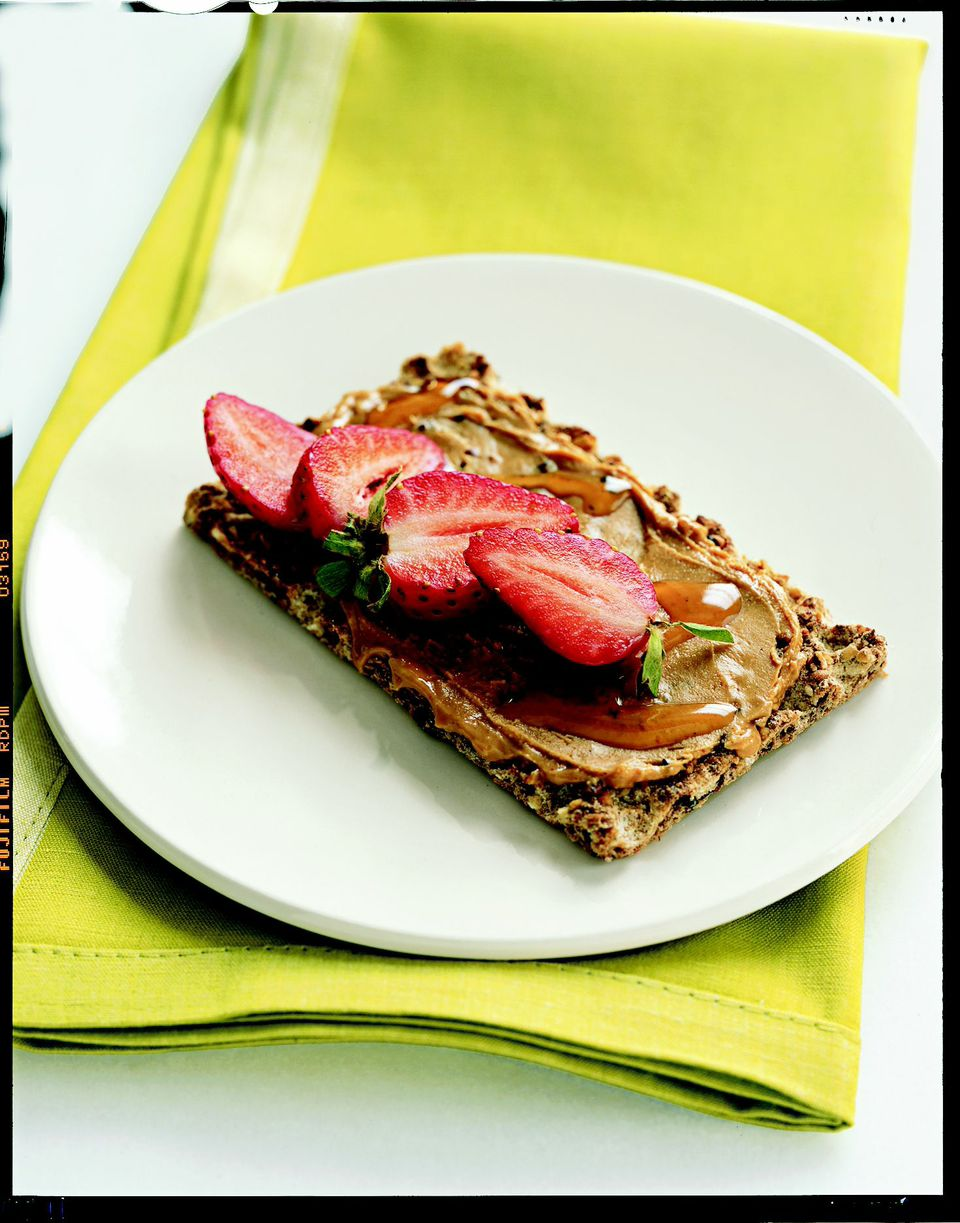 1. Cashew-Strawberry Crunch Think of this as a gourmet cook's PB & J. Spread 1 tablespoon of cashew butter on a slice of Ryvita Fruit Crunch. (Or substitute peanut butter and Triscuits.) Drizzle with ½ tablespoon honey and top with sliced strawberries.                                                              Health bonus: Nut butters are full of heart-healthy monounsaturated fats.