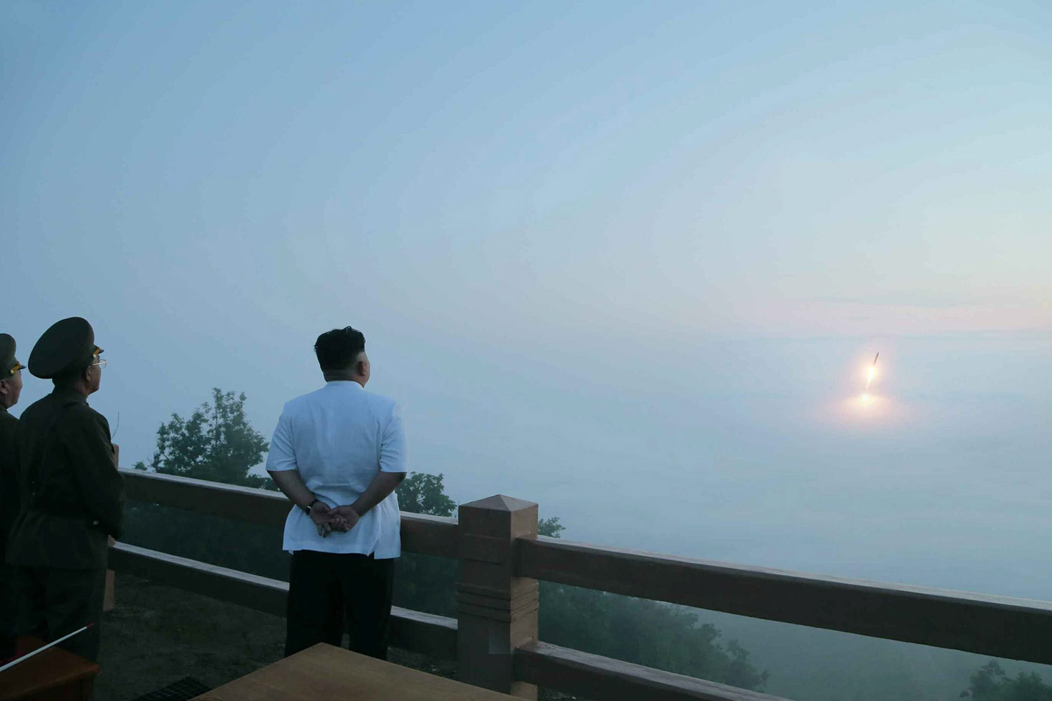 A picture released by the Rodong Sinmun, the newspaper of the ruling North Korean Workers Party released on 30 June 2014, shows North Korean leader Kim Jong-un observing a tactical rocket firing drill of the North's Strategic Force at an unidentified place.