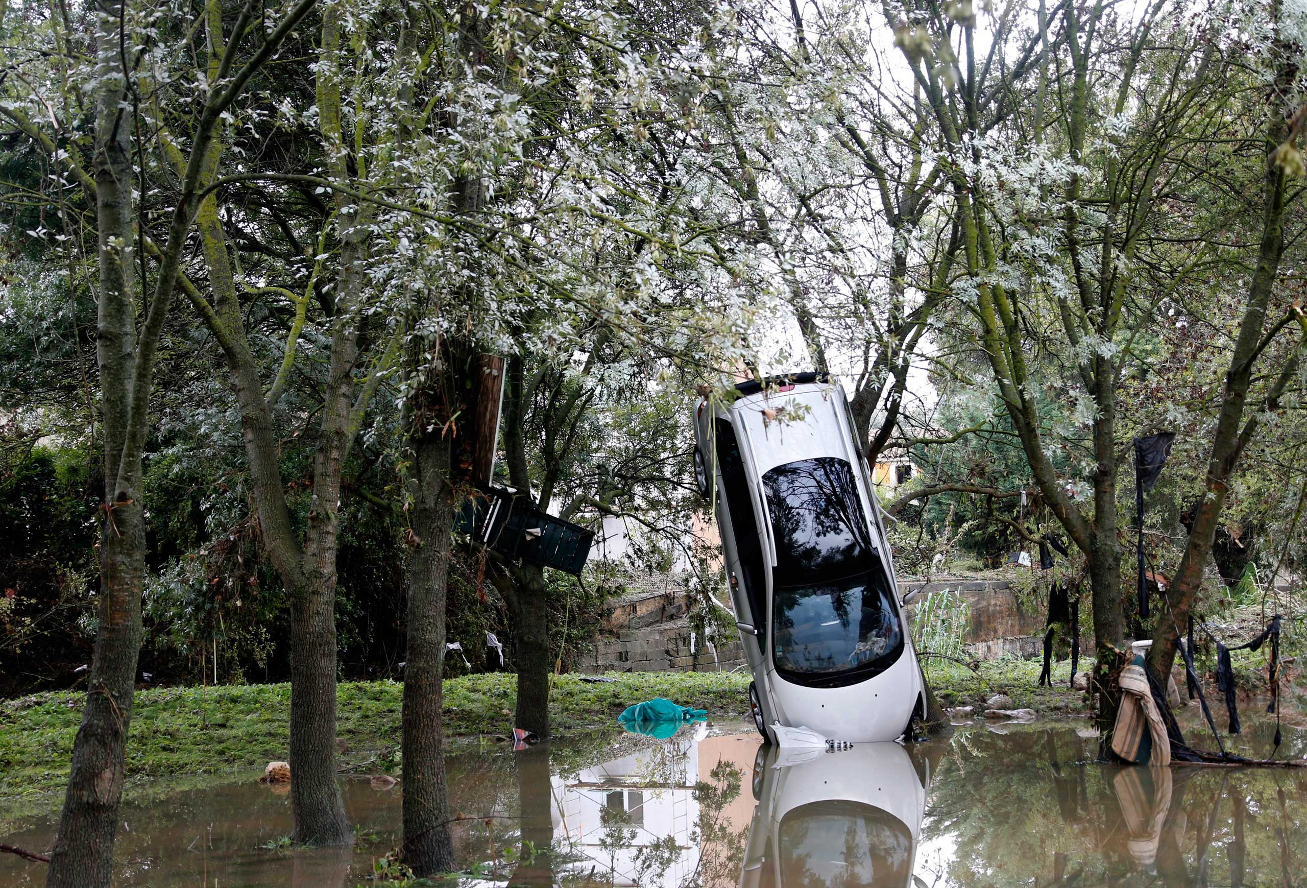 Oct. 7, 2014. A destroyed car hangs from a tree after heavy floods in Grabels, near Montpellier, Southern France. Parts of Montpellier lay under water after the Lez river, which flows through the city, burst its banks.