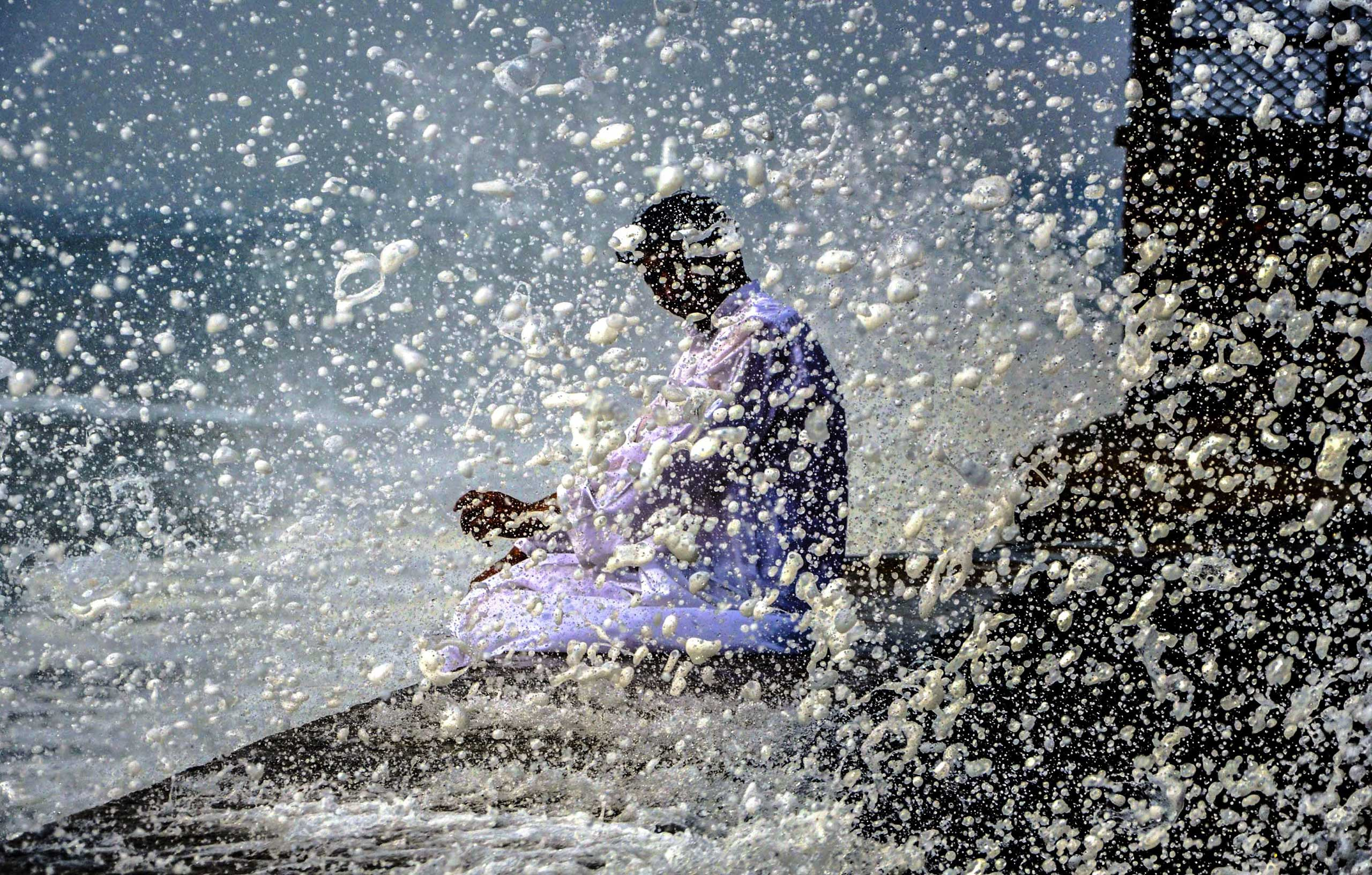 Oct. 28, 2014. A man sits at the beach in Karachi. A tropical cyclone named Nilofar was heading for western India from over the Arabian Sea, prompting authorities to take precautionary measures.
