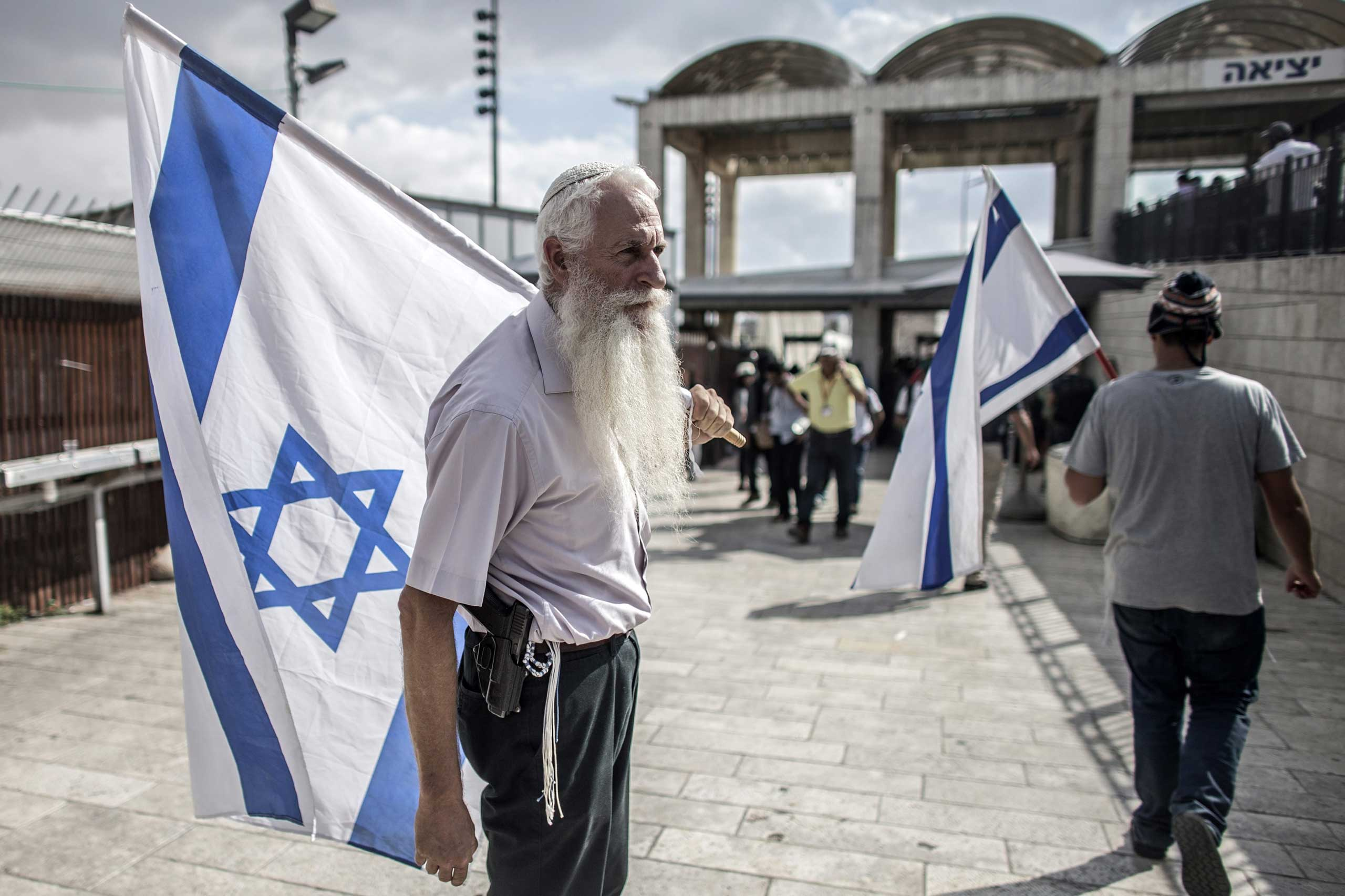 Oct. 30, 2014. An armed Israeli right wing activists stand at the entrance to the Western Wall and the Al-Aqsa compound, the third most holiest site in Islam, in Jerusalem's Old City. Israeli authorities close the compound for the first time since the second Intifada following an assassination attempt of the Israeli right-wing activist Rabbi Yehuda Glick.