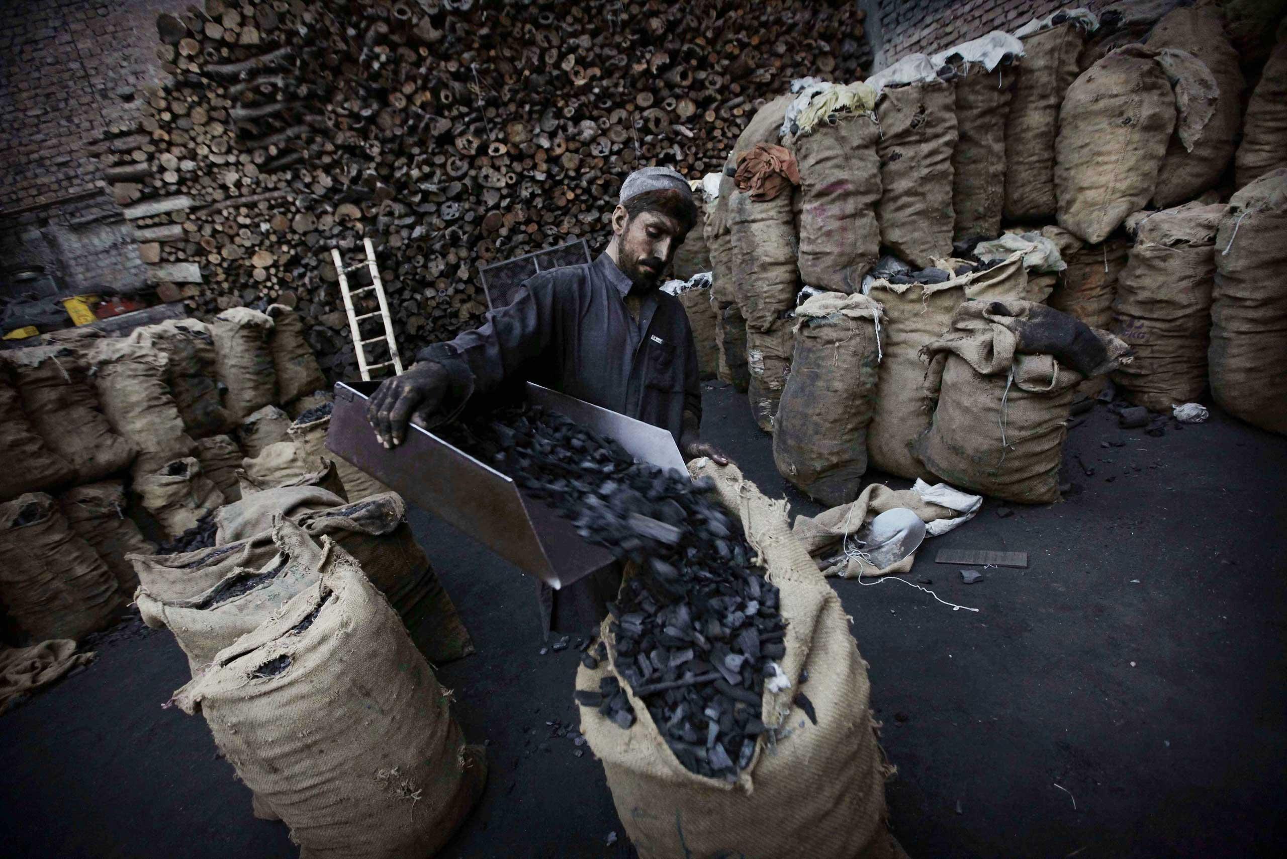 Oct. 30, 2014. A laborer sells coal in Peshawar, Pakistan.