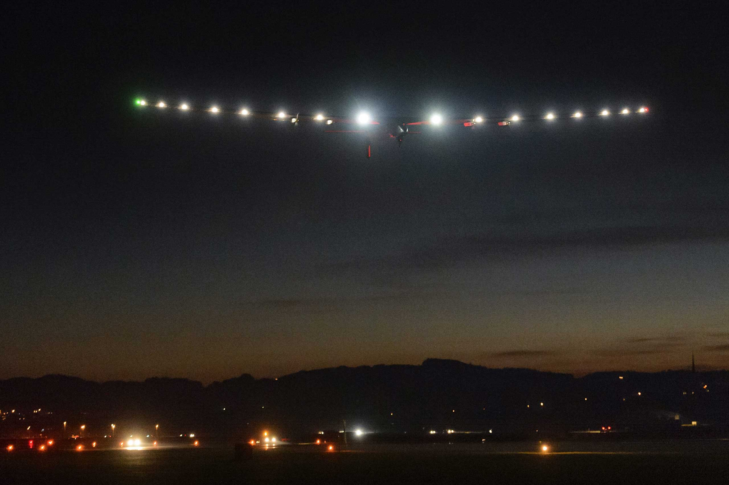 Oct. 30, 2014. The new experimental aircraft, Solar Impulse 2 HB-SIB, flies at night during a test flight with Solar Impulse's Chief Executive Officer and pilot Andre Borschberg at the airbase in Payerne, Switzerland.