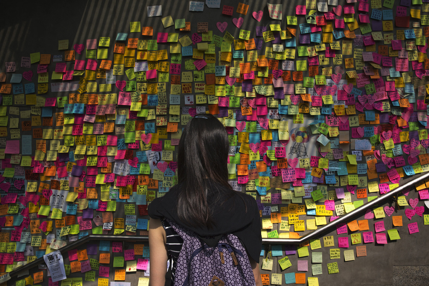 On a wall just outside Hong Kong's main government offices, protesters leave words of support for one another and demands for political action.