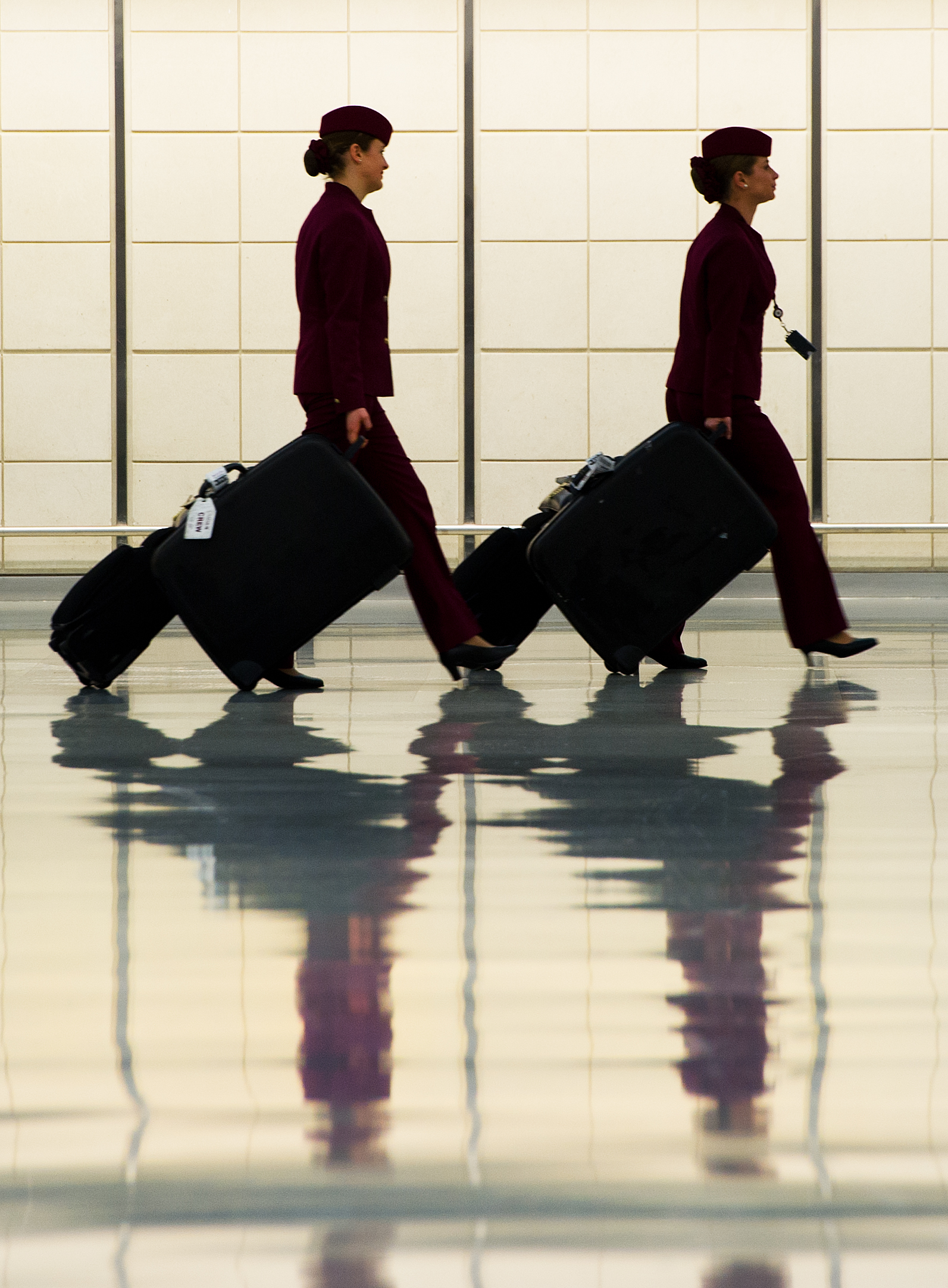 Two flight attendants walk in the luggage claim area of the US Customs and Immigration  at Dulles International Airport on Dec. 21, 2011 near Washington, DC.