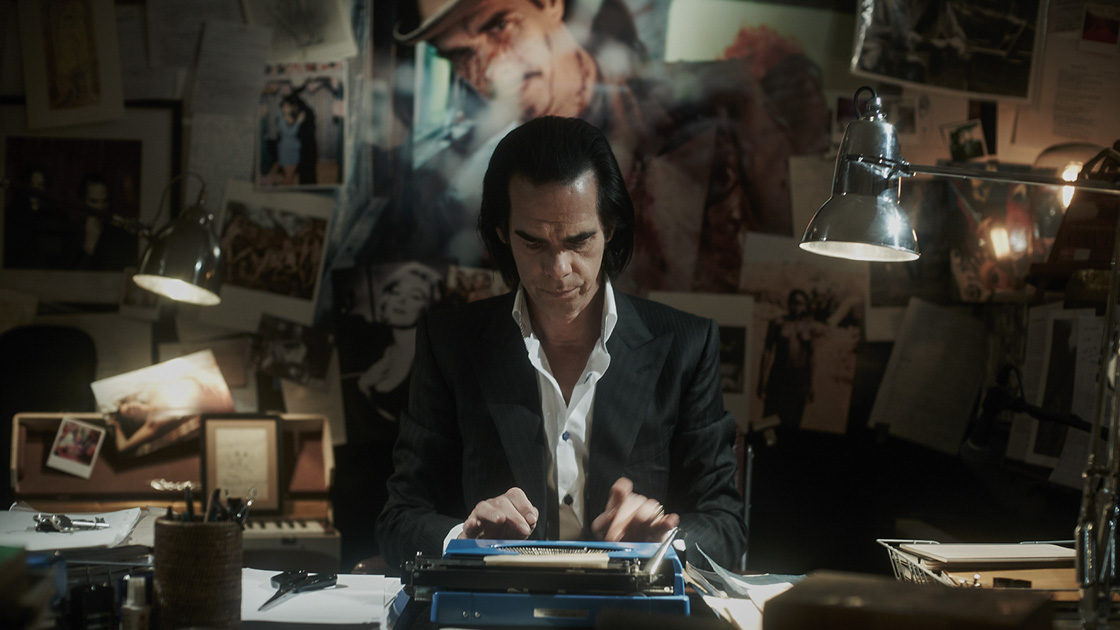 The fake Nick Cave pretends to write in 20,000 Days on Earth.