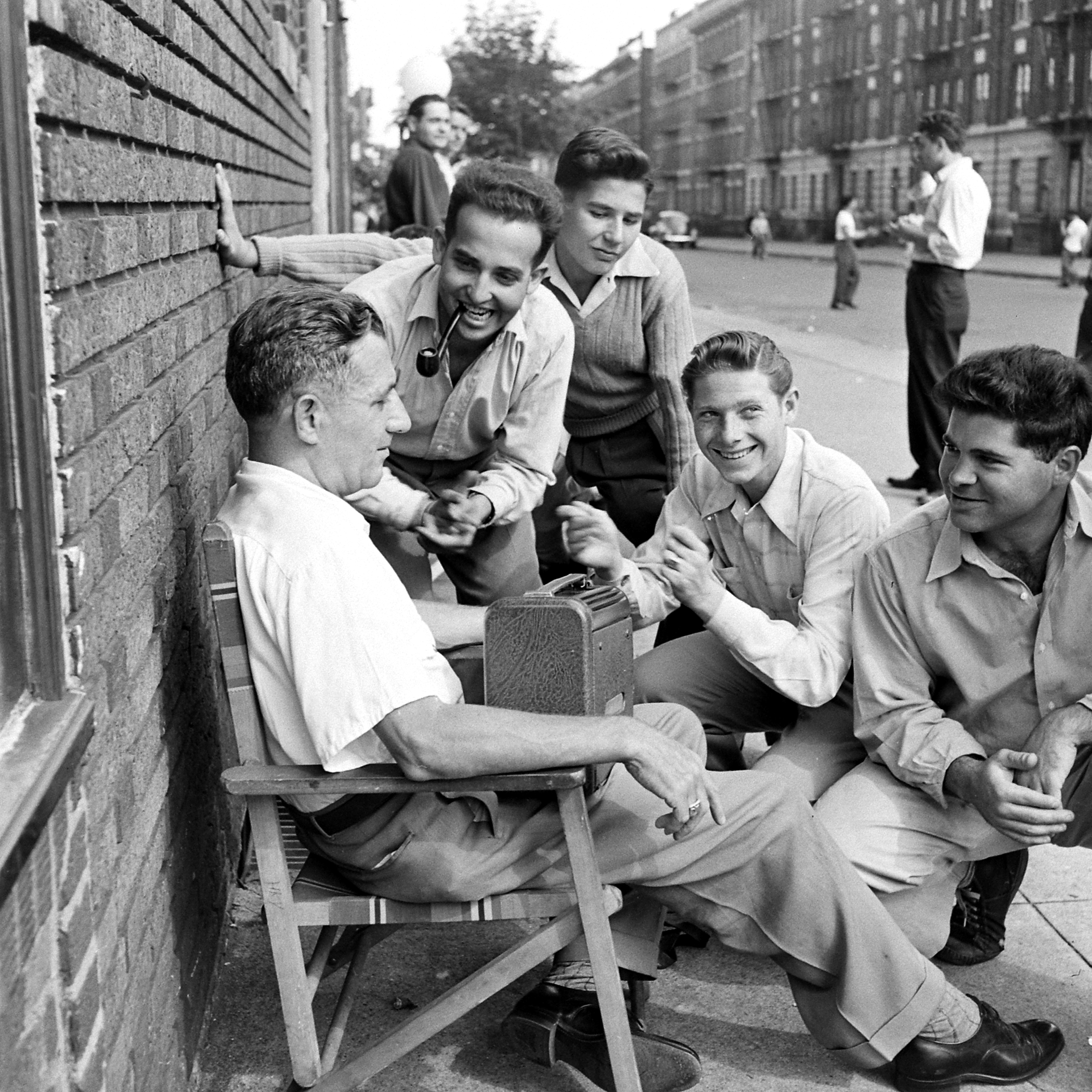 Listening to a Dodgers-Giants ballgame on the radio, Brooklyn, 1946.