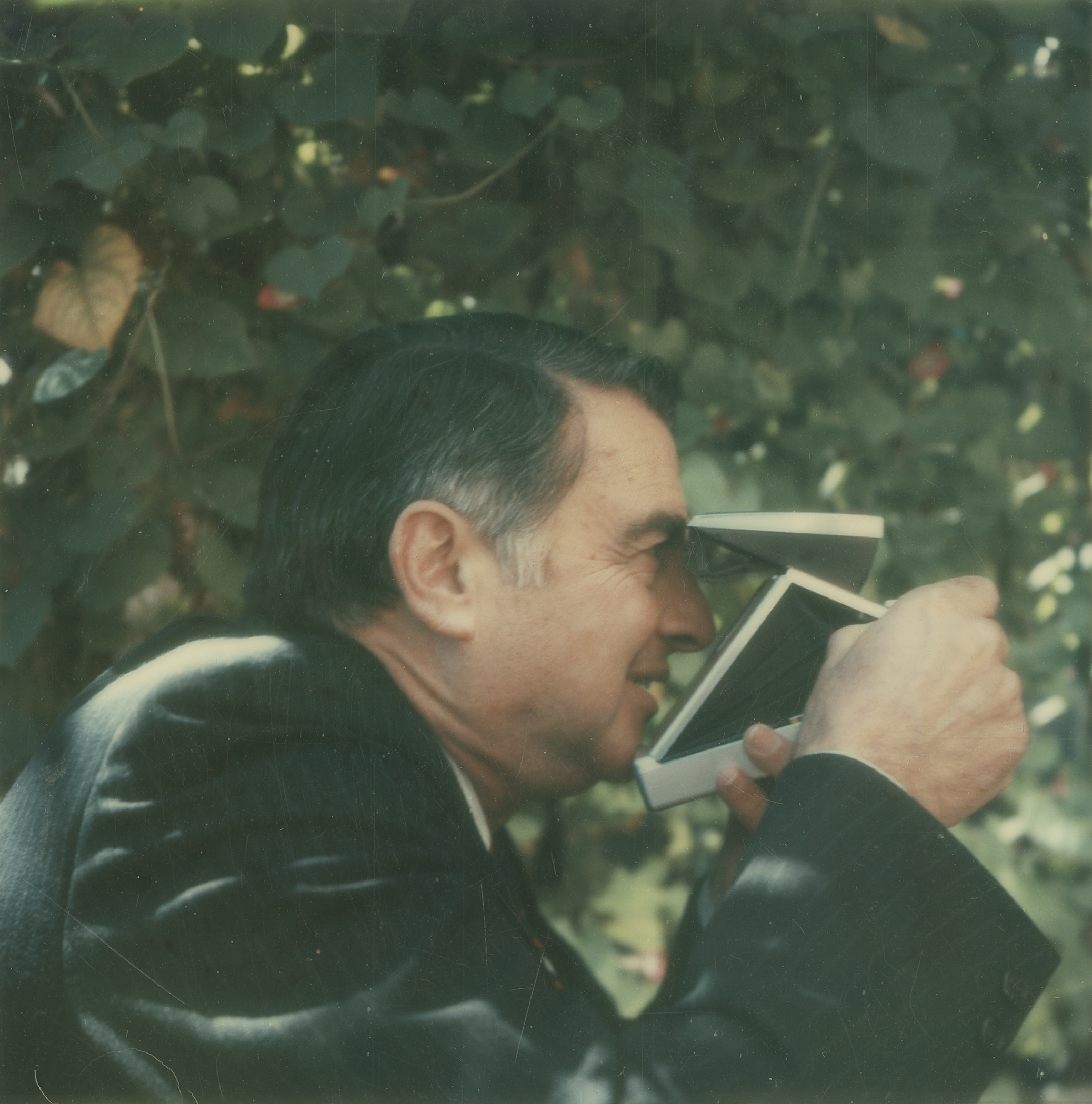 Edwin H. Land using one of his own creations, a Polaroid Land Camera, in 1972.