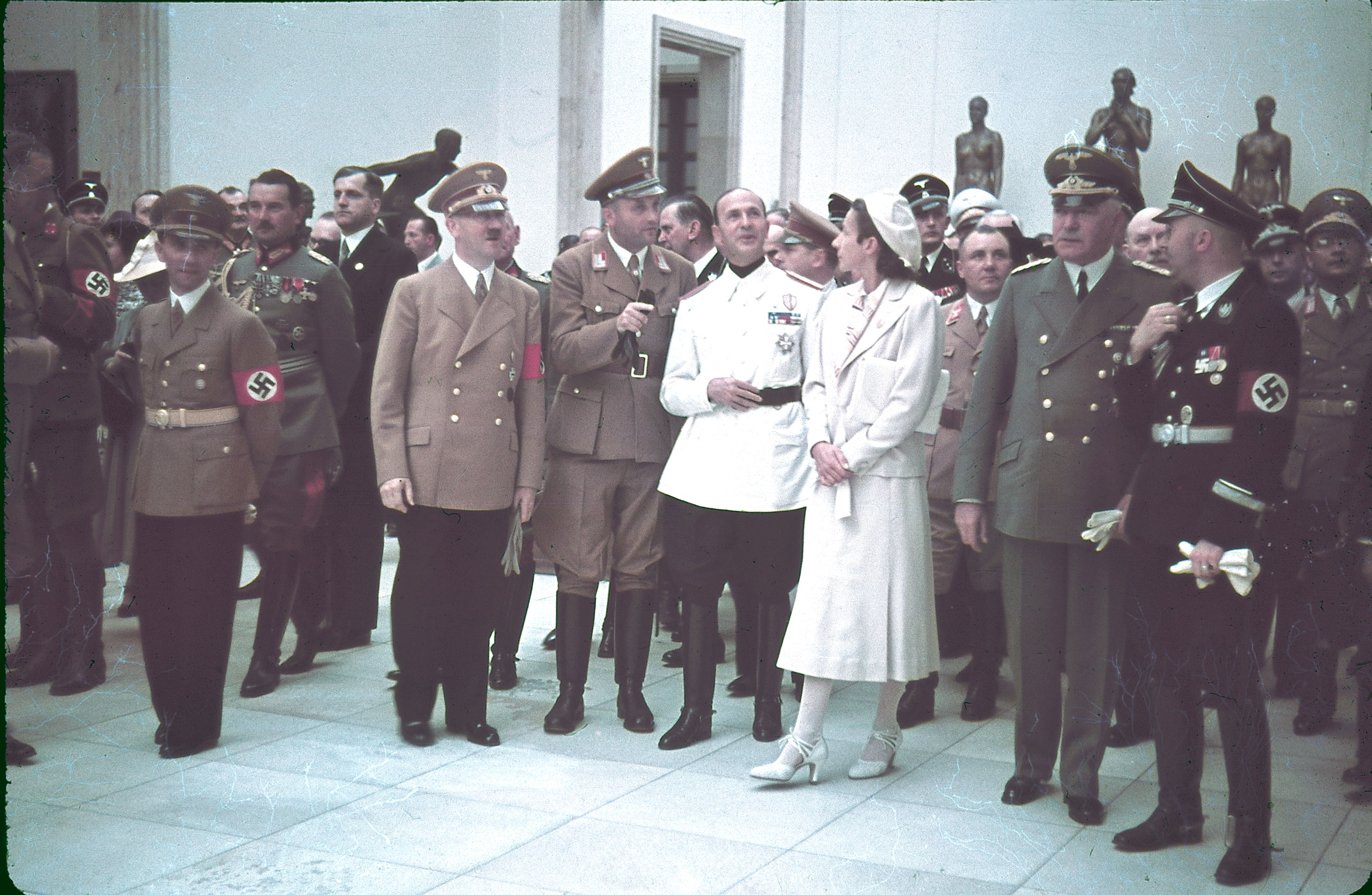 Joseph Goebbels, Eugen Ritter von Schobert, Adolf Hitler, Italian ambassador Dino Alfieri (in white jacket), architect Gerdy Troost, Martin Bormann (behind Troost), Heinrich Himmler (far right) and others at Munich's Haus der Kunst for the 1939  Day of German Art.