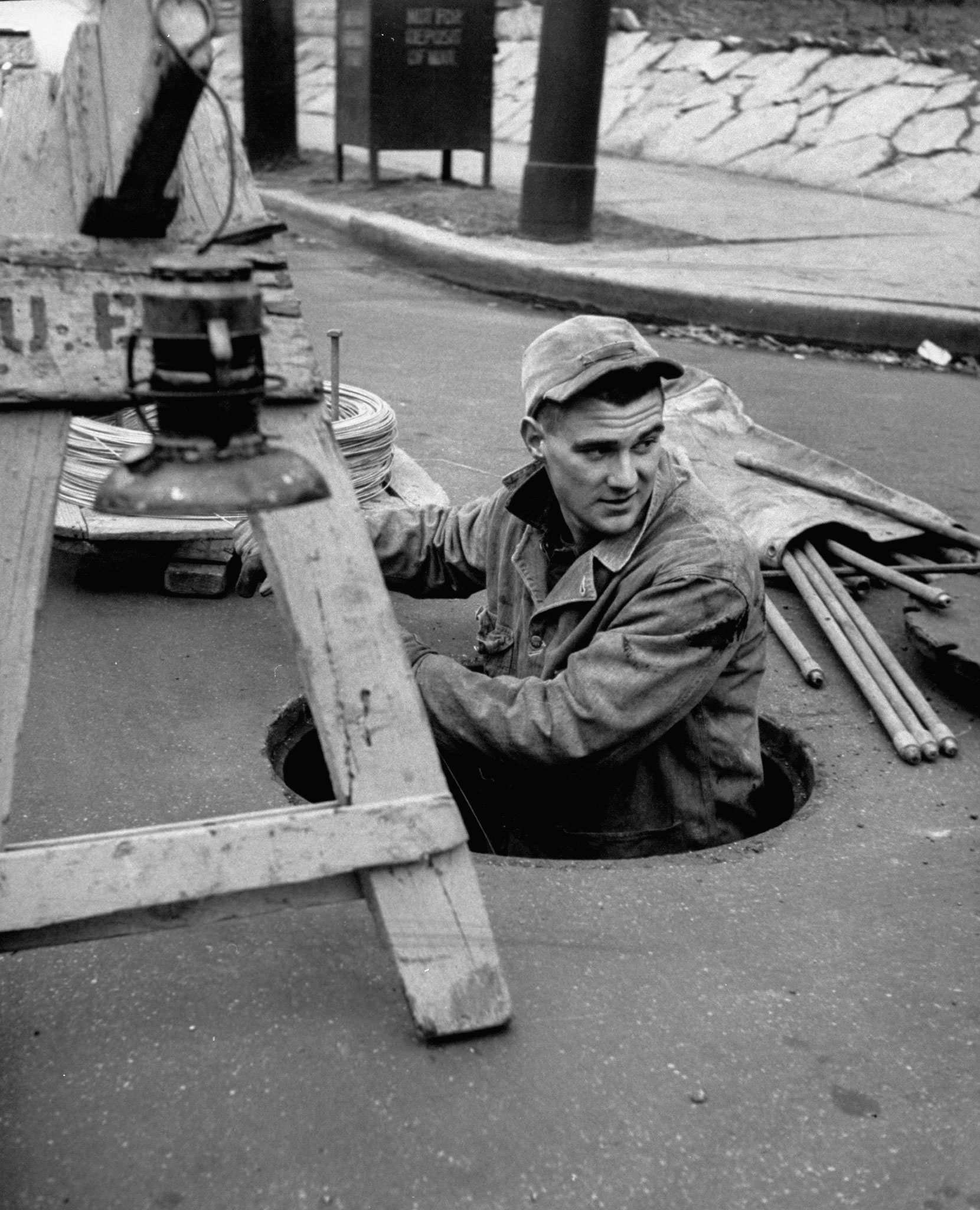 <b>Caption from LIFE.</b> Utility worker, Jack Krueger, 19, who finished high school in 1952, earns $2.24 an hour.