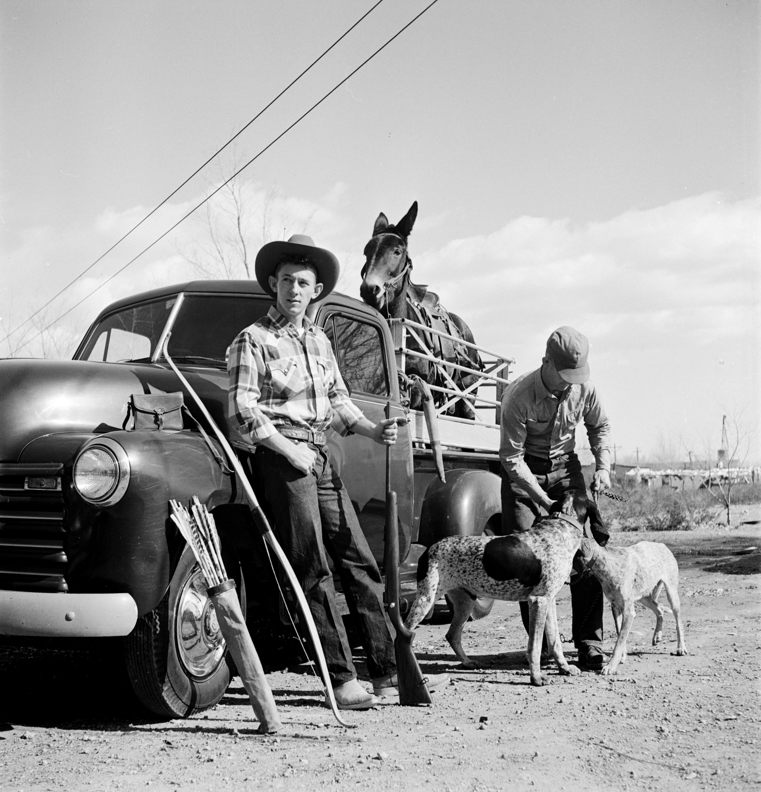 <b>Caption from LIFE.</b> Sonny Thayer, 19, packs for hunting trip.