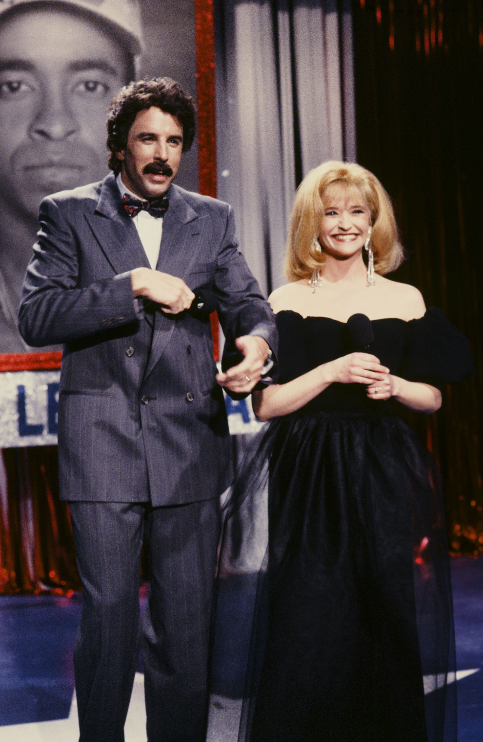 Kevin Nealon as Tom Selleck, Jan Hooks as Barbara Mandrell during the 'All Star Celebrity Tribute' skit on April 20, 1991.
