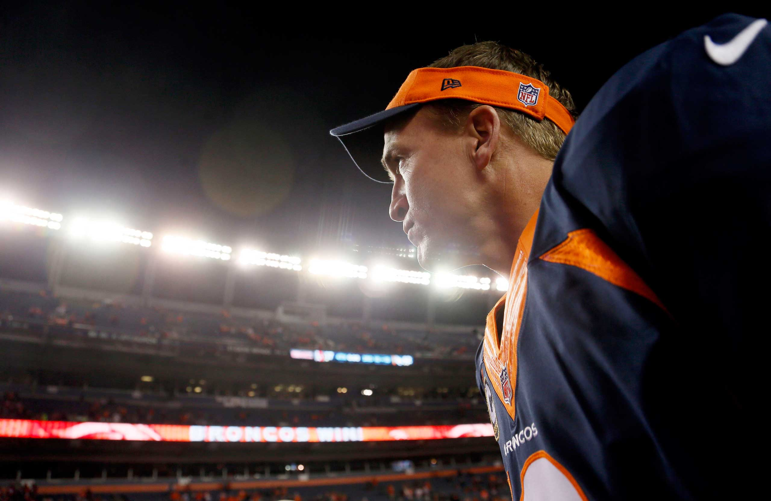 Oct. 19, 2014. Denver Broncos quarterback Peyton Manning leaves the field after an NFL football game against the San Francisco 49ers in Denver. Manning has broken Brett Favre's record for touchdown passes with his 509th. The Broncos won 42-17.