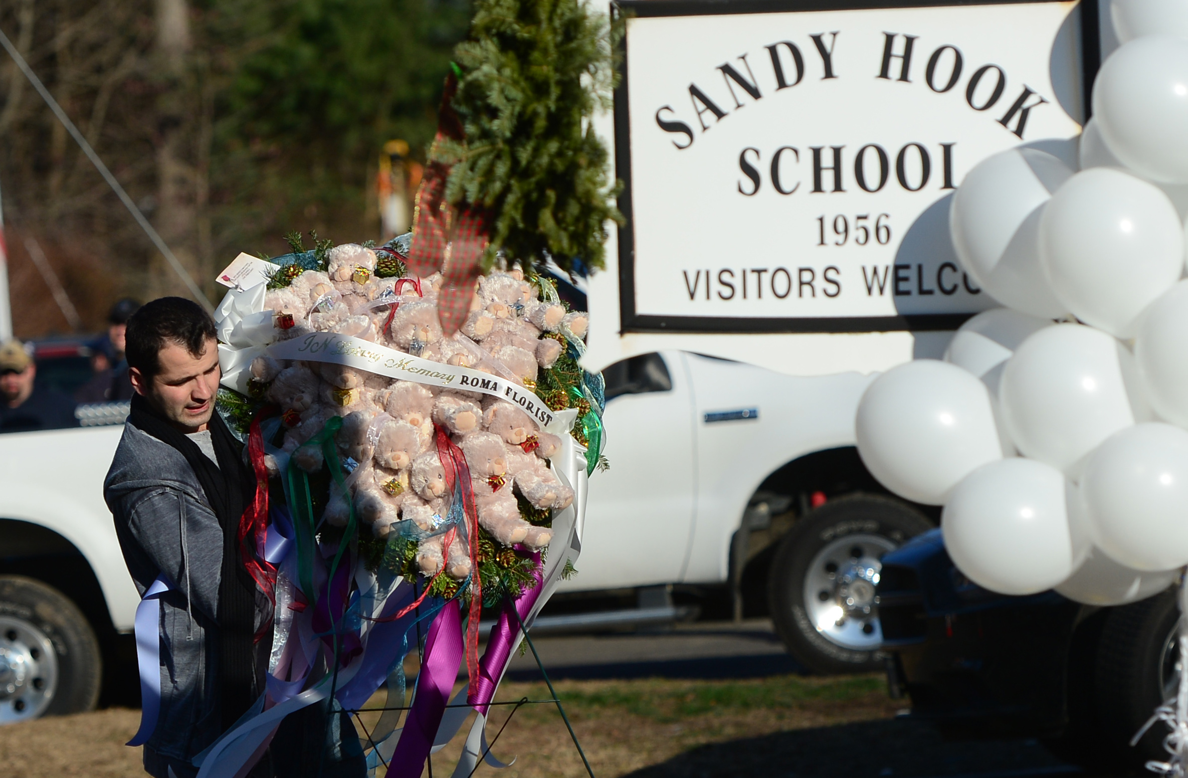 A man pays tribute to the victims of an elementary school shooting in Newtown, Connecticut, on December 15, 2012.