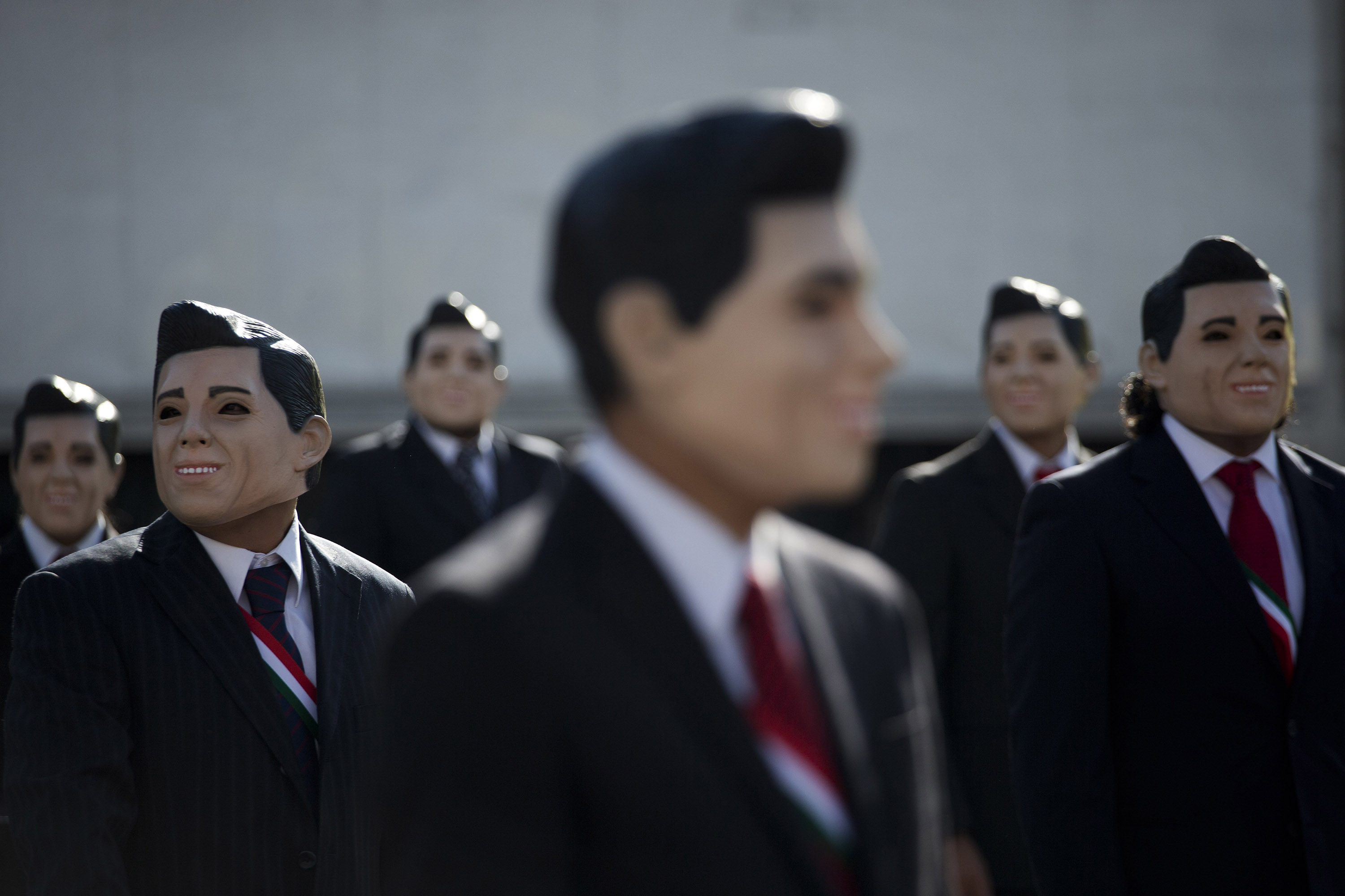 Greenpeace protestors wear masks of Mexican President Enrique Pena Nieto as they demonstrate in front of the National Palace in Mexico City, on Oct. 23, 2014.