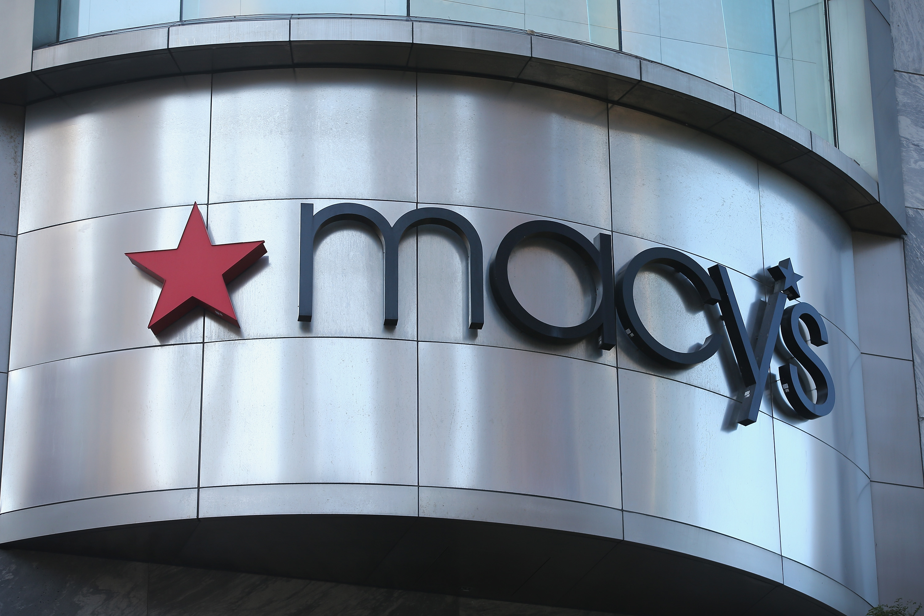 A sign hangs above Macy's in the Magnificent Mile shopping district on August 14, 2013 in Chicago, Illinois.
