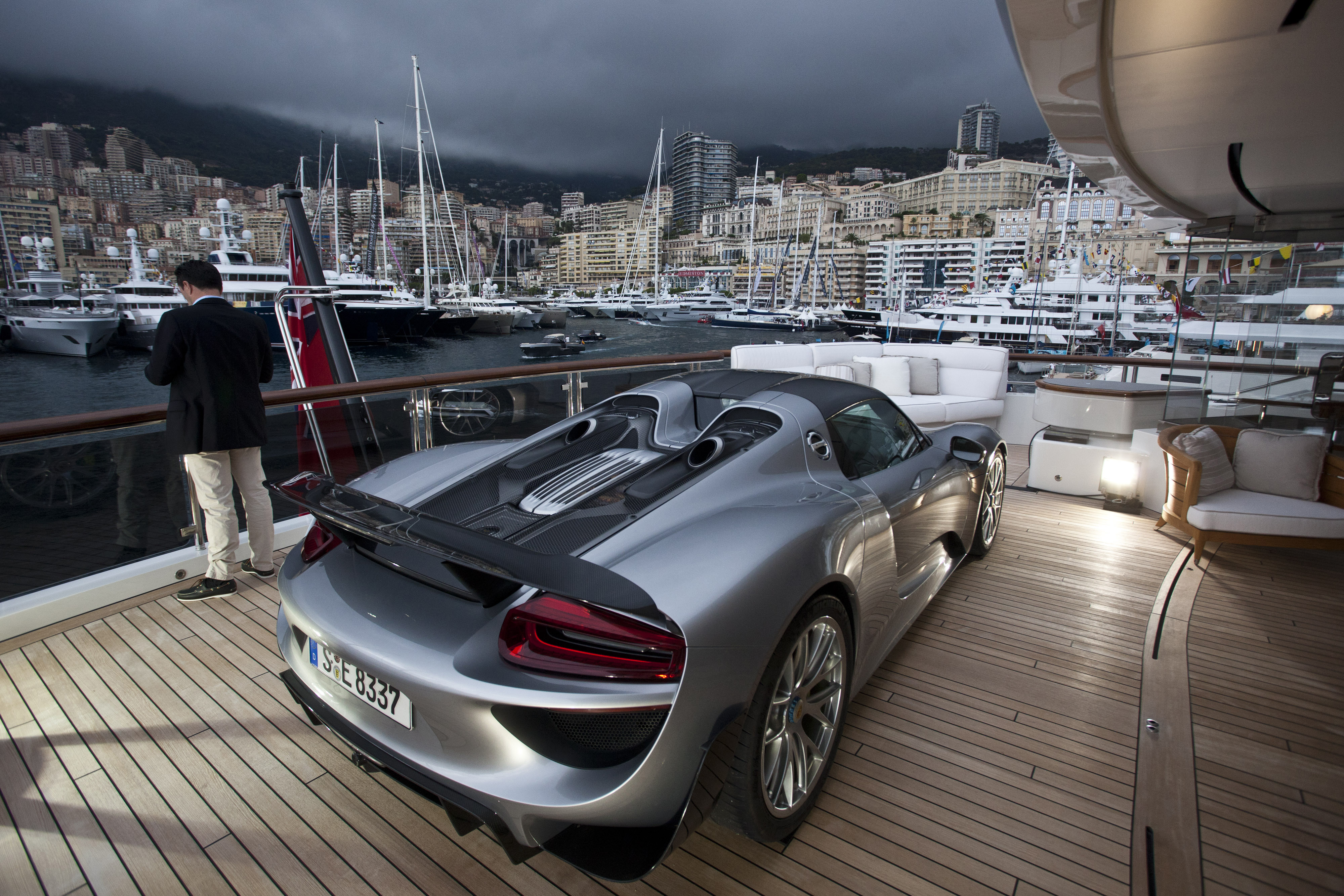 A Porsche 918 Spyder automobile, produced by Porsche SE, sits on the deck of the 88m luxury superyacht  Quattroelle, in Monaco, France, on Wednesday, Sept. 25, 2013.