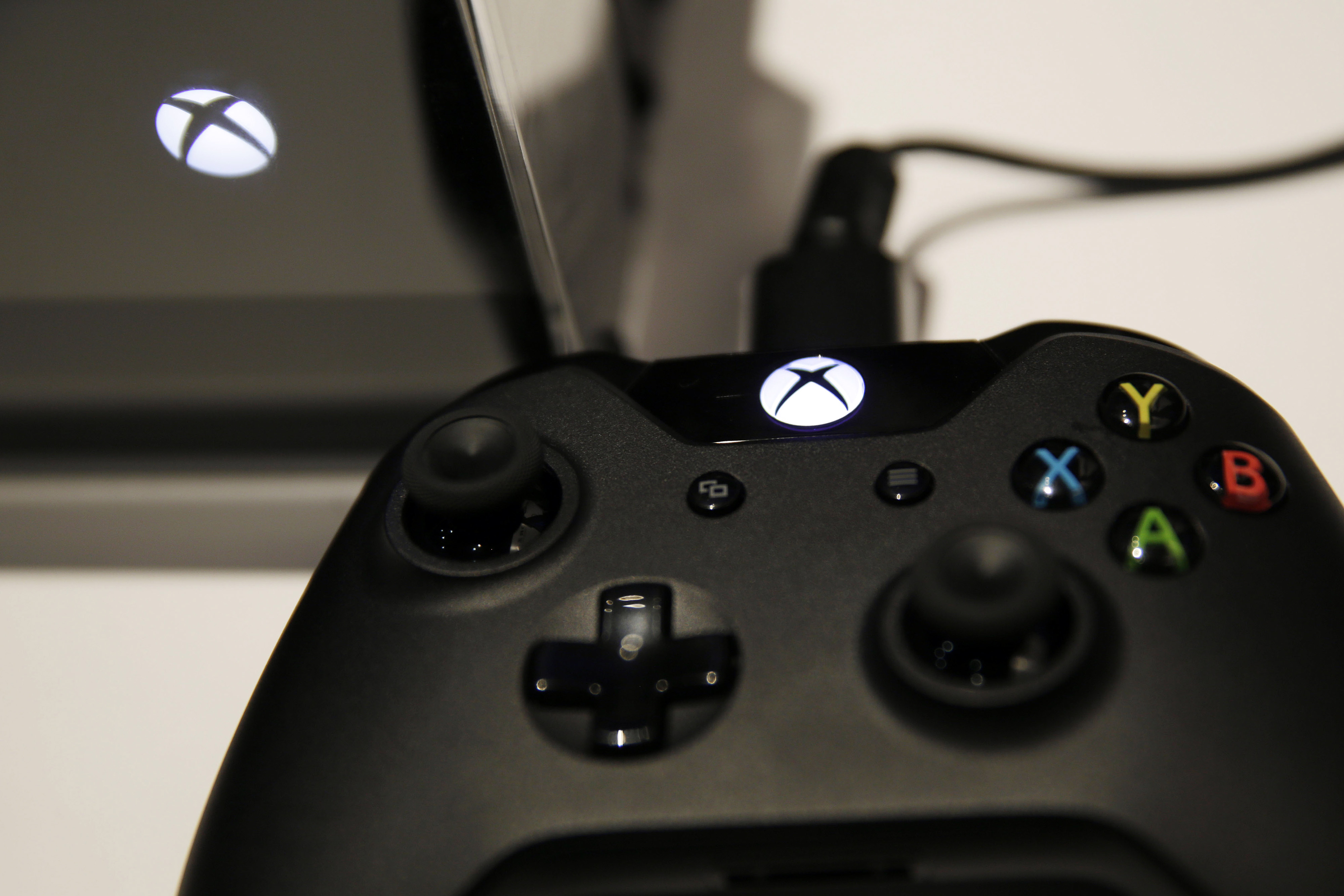 A logo sits on an Xbox One games controller during the Eurogamer Expo 2013 in London, U.K., on Saturday, Sept. 28, 2013.