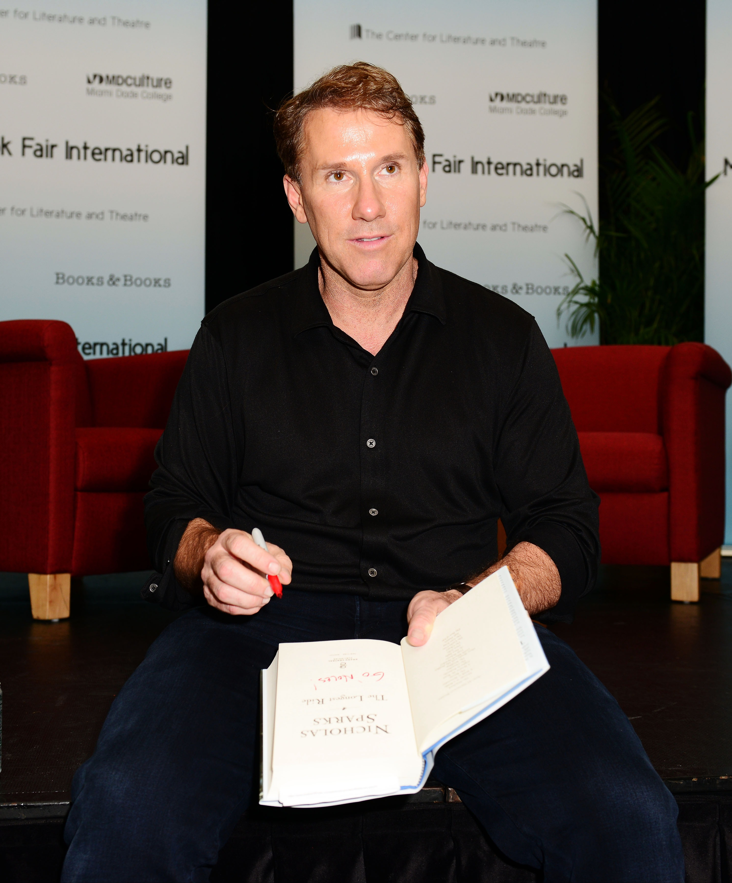 Author Nicholas Sparks discusses his book  The Longest Ride  presented by Books and Books at Chapman Conference Center at Miami Dade College on Sept. 30, 2013 in Miami.