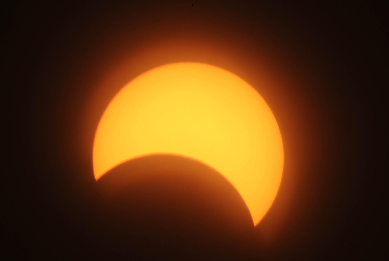 A partial solar eclipse is seen over the Sudanese capital Khartoum on November 3, 2013.