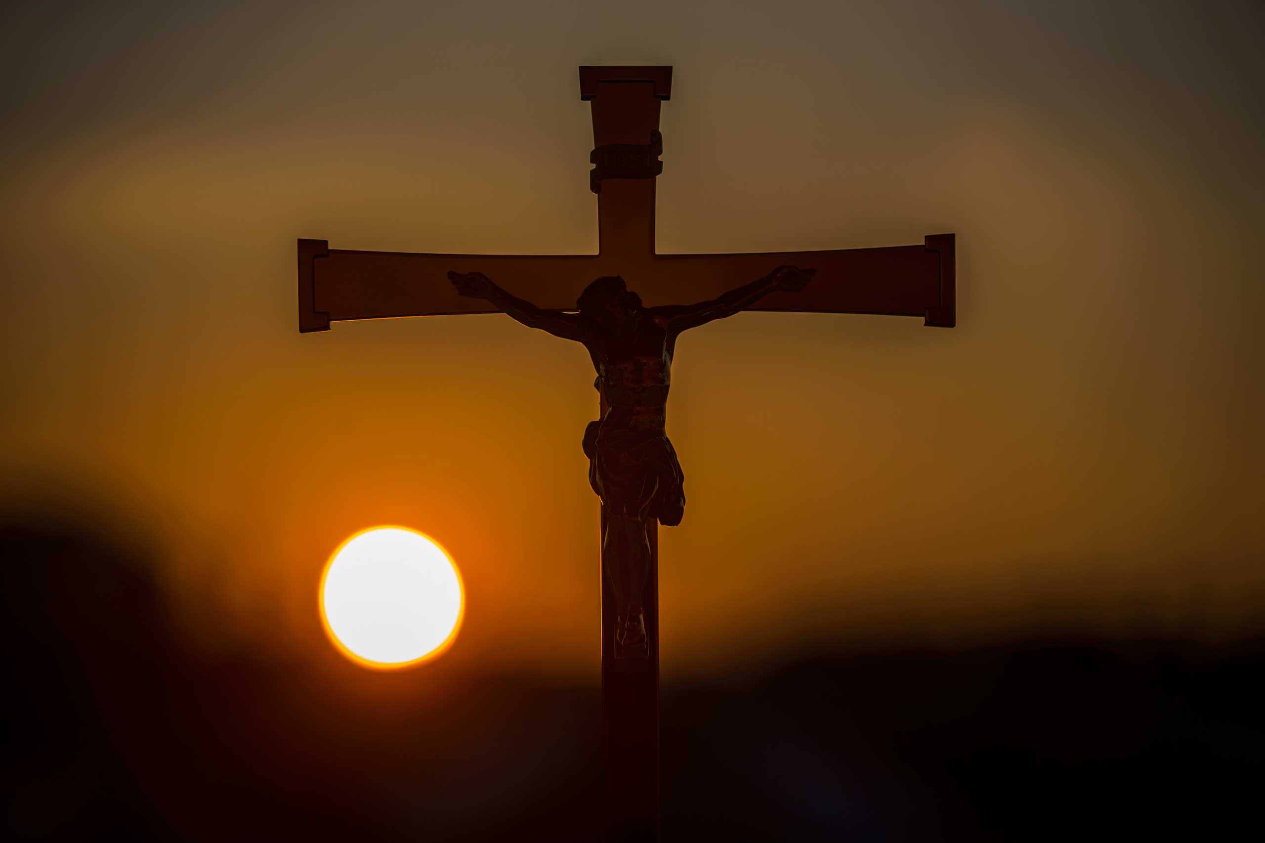 Sept. 26, 2014. The sun sets as a cross is placed at the alter, during the preparation for Opus Dei Bishop Alvaro del Portillo's mass beatification, in Madrid, Spain.