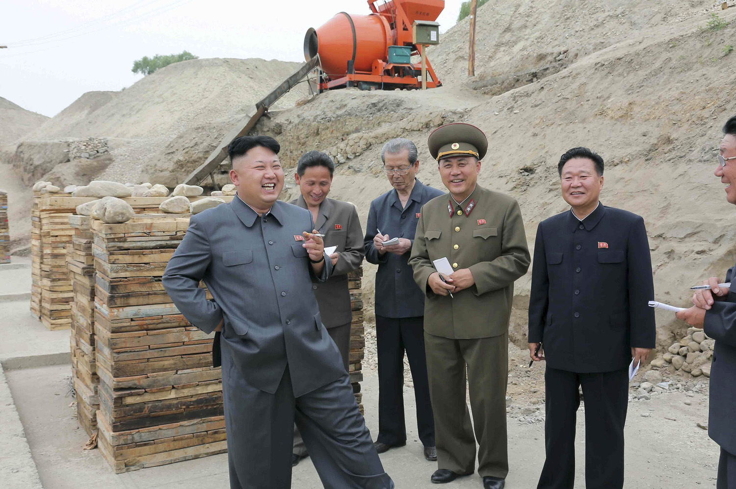 North Korean leader Kim Jong Un smokes a cigarette as he gives guidance on the development of Ssuk Islet in this undated photo released by North Korea's Korean Central News Agency (KCNA) in Pyongyang June 2, 2014.
