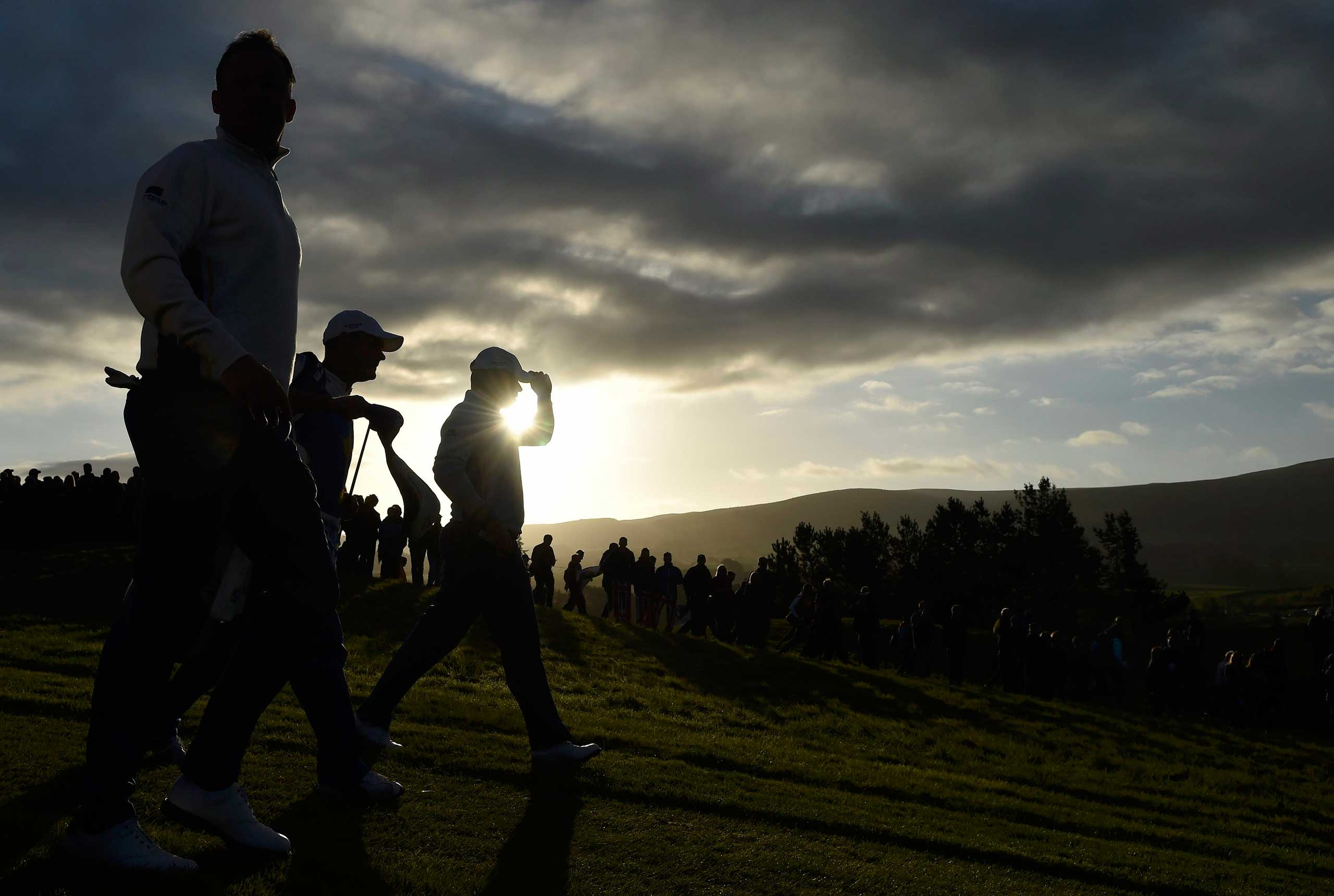 Sept. 27, 2014. European Ryder Cup players Jamie Donaldson (L) and Lee Westwood (R) walk along the second fairway during their fourballs 40th Ryder Cup match at Gleneagles in Scotland.