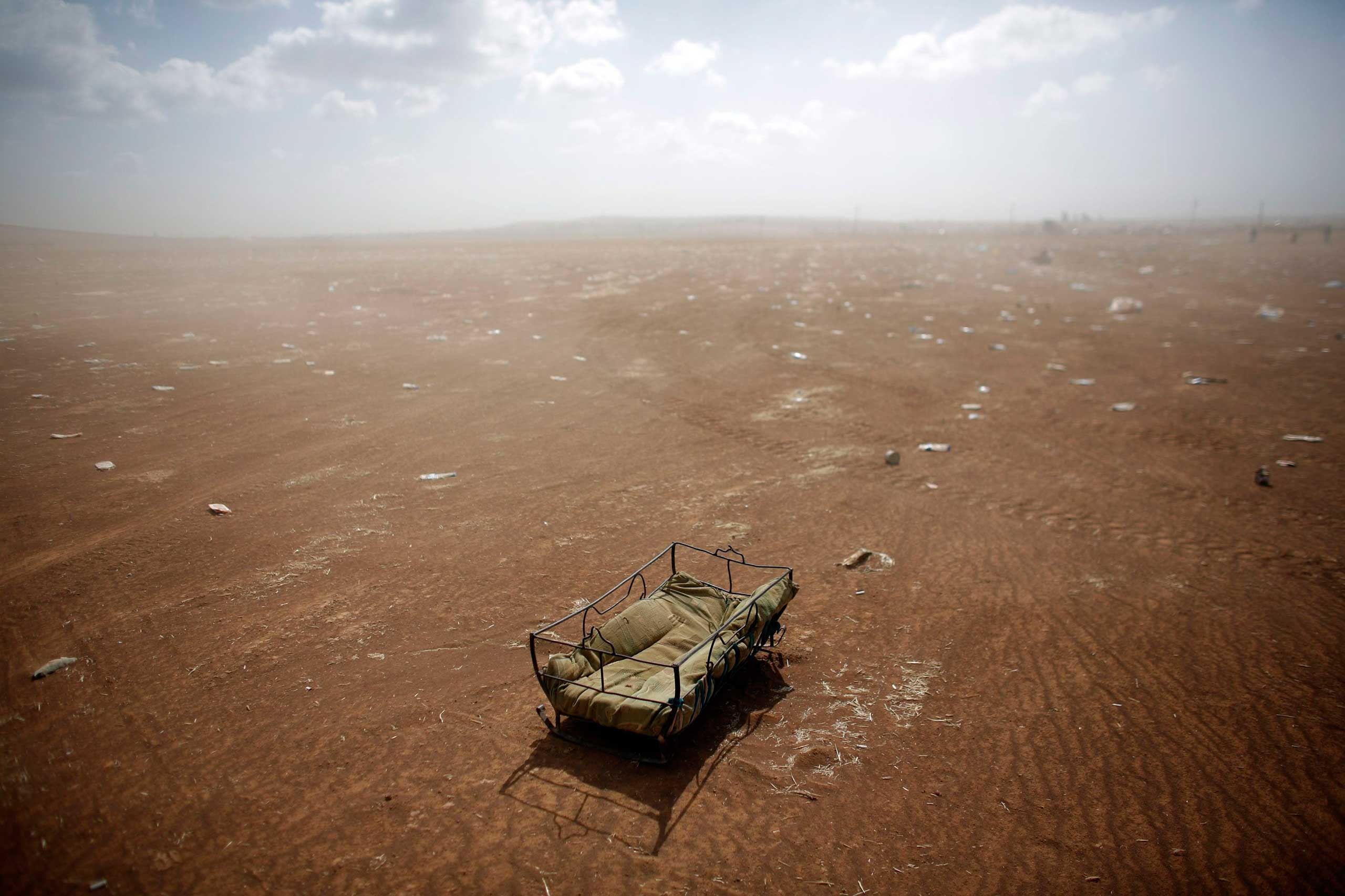 Sept. 27, 2014. A cradle left behind by Syrian Kurdish refugees lies at the Turkish-Syrian border near the southeastern town of Suruc in Sanliurfa province.