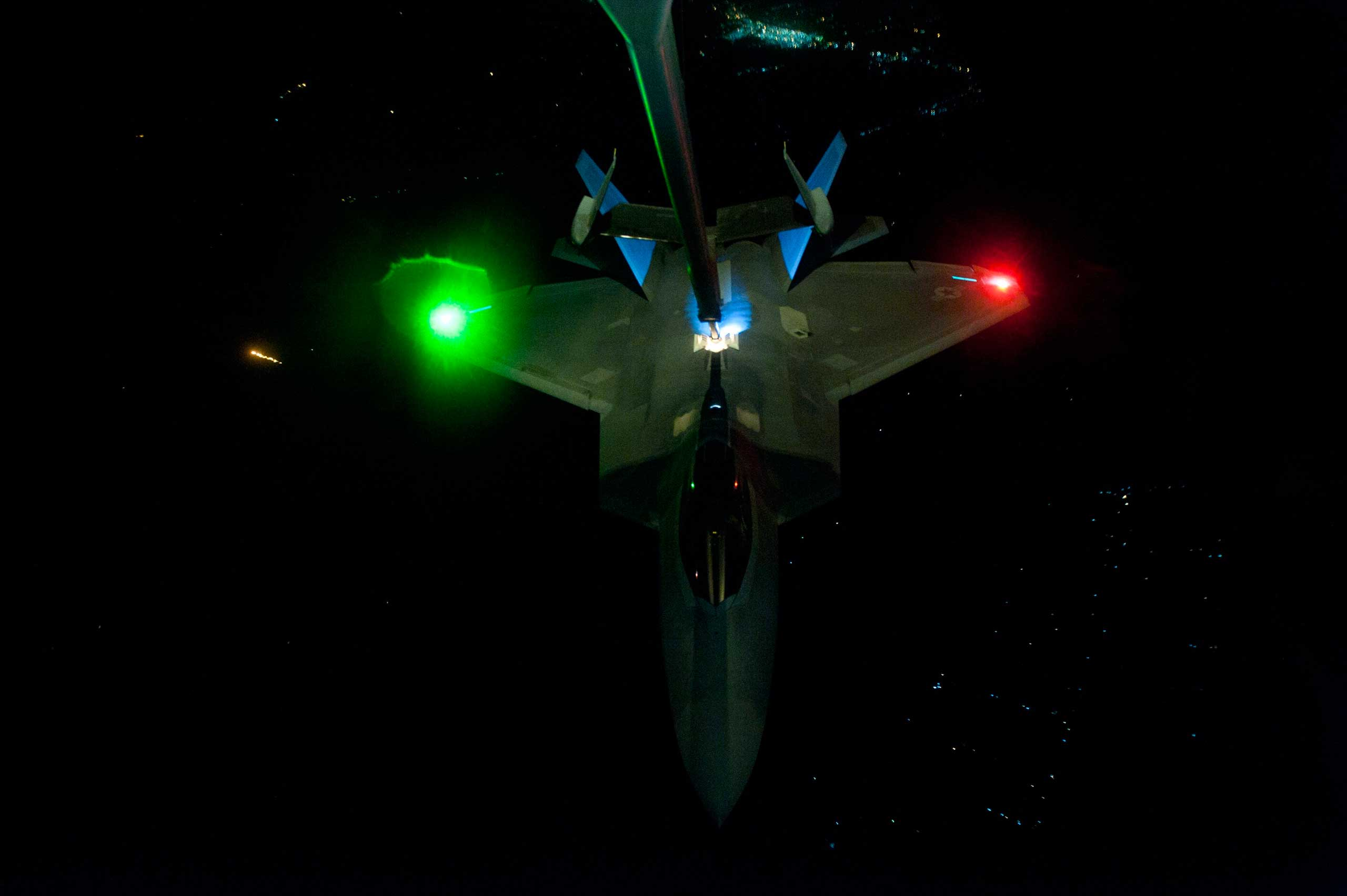 Sept. 26, 2014. A U.S. Air Force KC-10 Extender refuels an F-22 Rapt or fighter aircraft prior to strike operations in Syria. These aircraft were part of a strike package that was engaging ISIL targets in Syria.