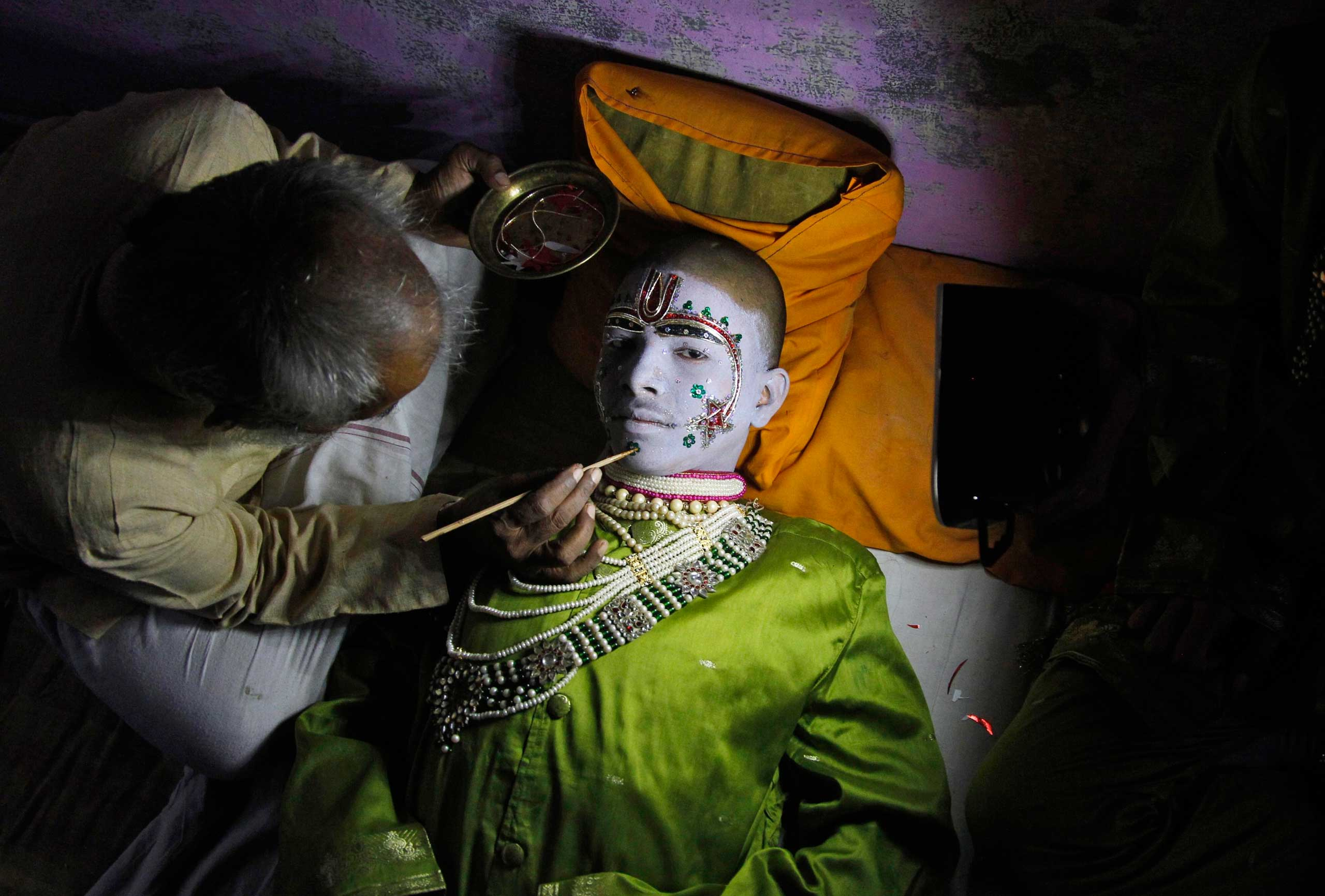 Sept. 30, 2014. Amit Kumar, 14, a performer, gets makeup applied before performing the role of the Hindu lord Rama in a religious play ahead of Dussehra in the northern Indian city of Allahabad. Effigies of the 10-headed demon king  Ravana  are burnt on Dussehra, the Hindu festival that commemorates the triumph of Lord Rama over the Ravana, marking the victory of good over evil.