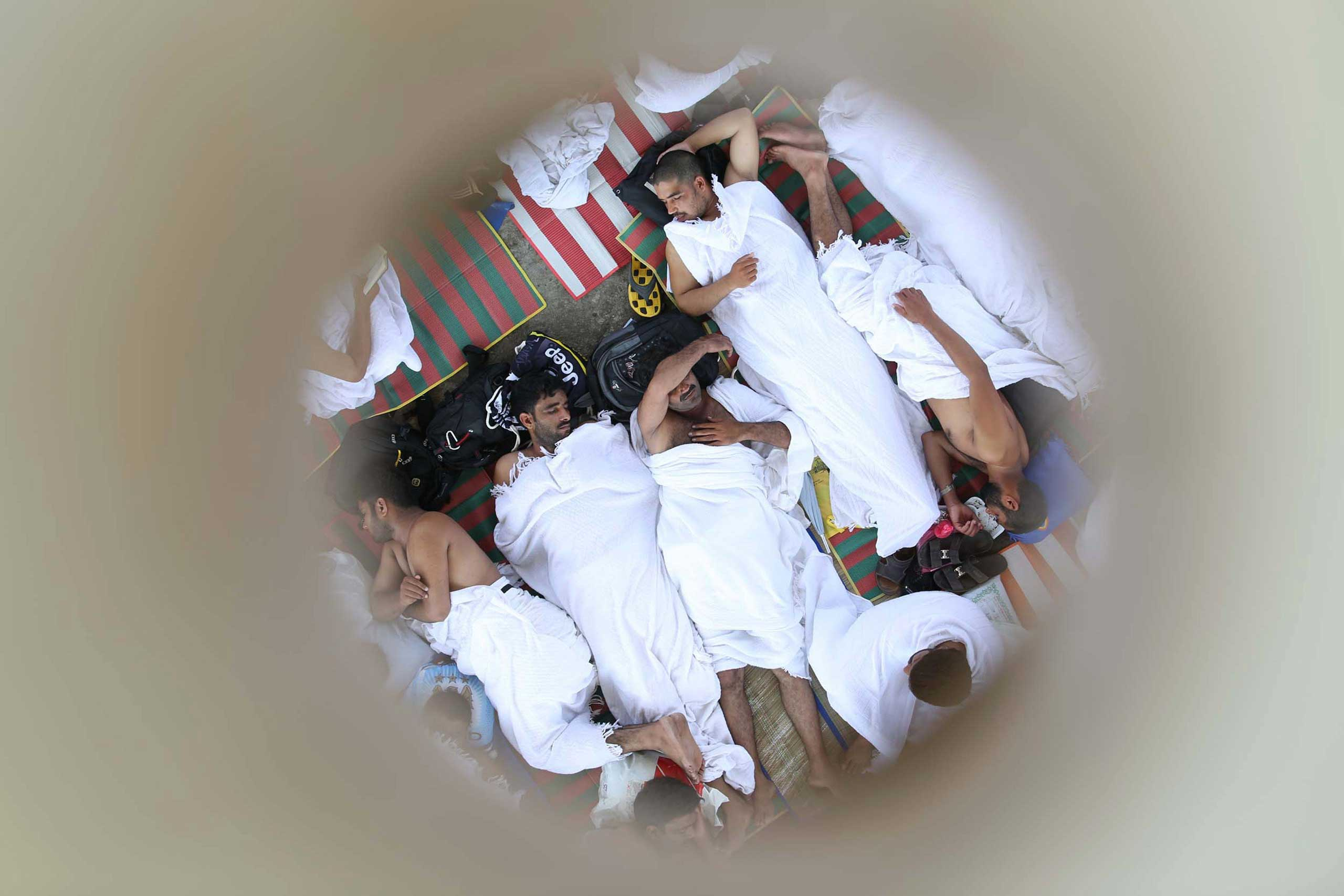 Oct. 2, 2014. Muslim pilgrims are pictured through a roof opening as they sleep during the annual haj pilgrimage in Mena, near the holy city of Mecca.