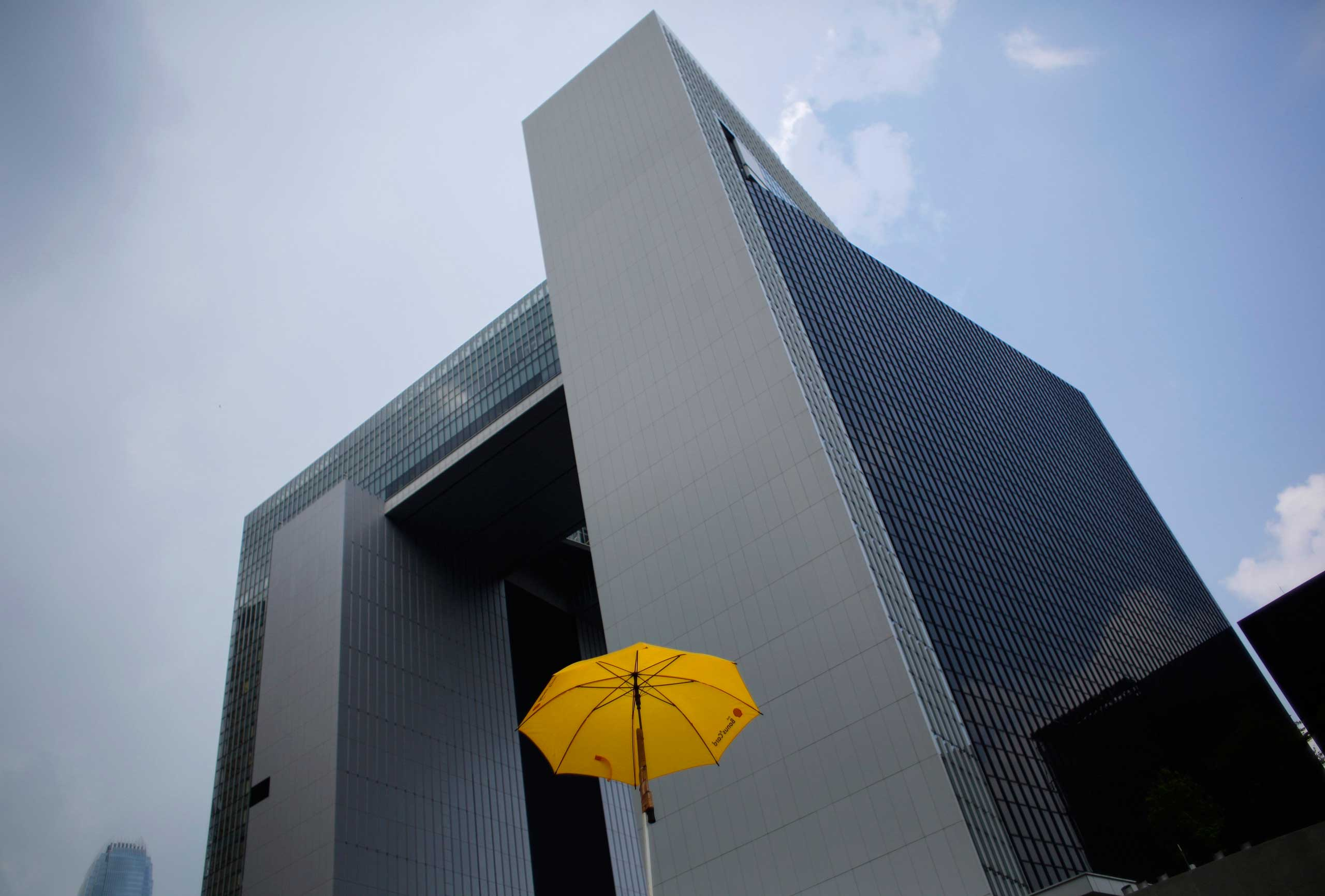 Oct. 3, 2014. A yellow umbrella, a symbol of what has been dubbed the 'Umbrella Revolution', is seen in front of the government headquarters building in Hong Kong. Hong Kong leader Leung Chun-ying agreed on Friday to open talks with pro-democracy protesters but he and his Chinese government backers made clear that they would not back down in the face of the city's worst unrest in decades.