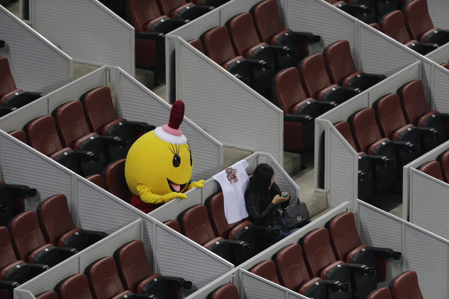 A costumed mascot waits for the men's quarter-final match between Rafael Nadal of Spain and Martin Klizan of Slovakia at the China Open tennis tournament in Beijing on Oct. 3, 2014.