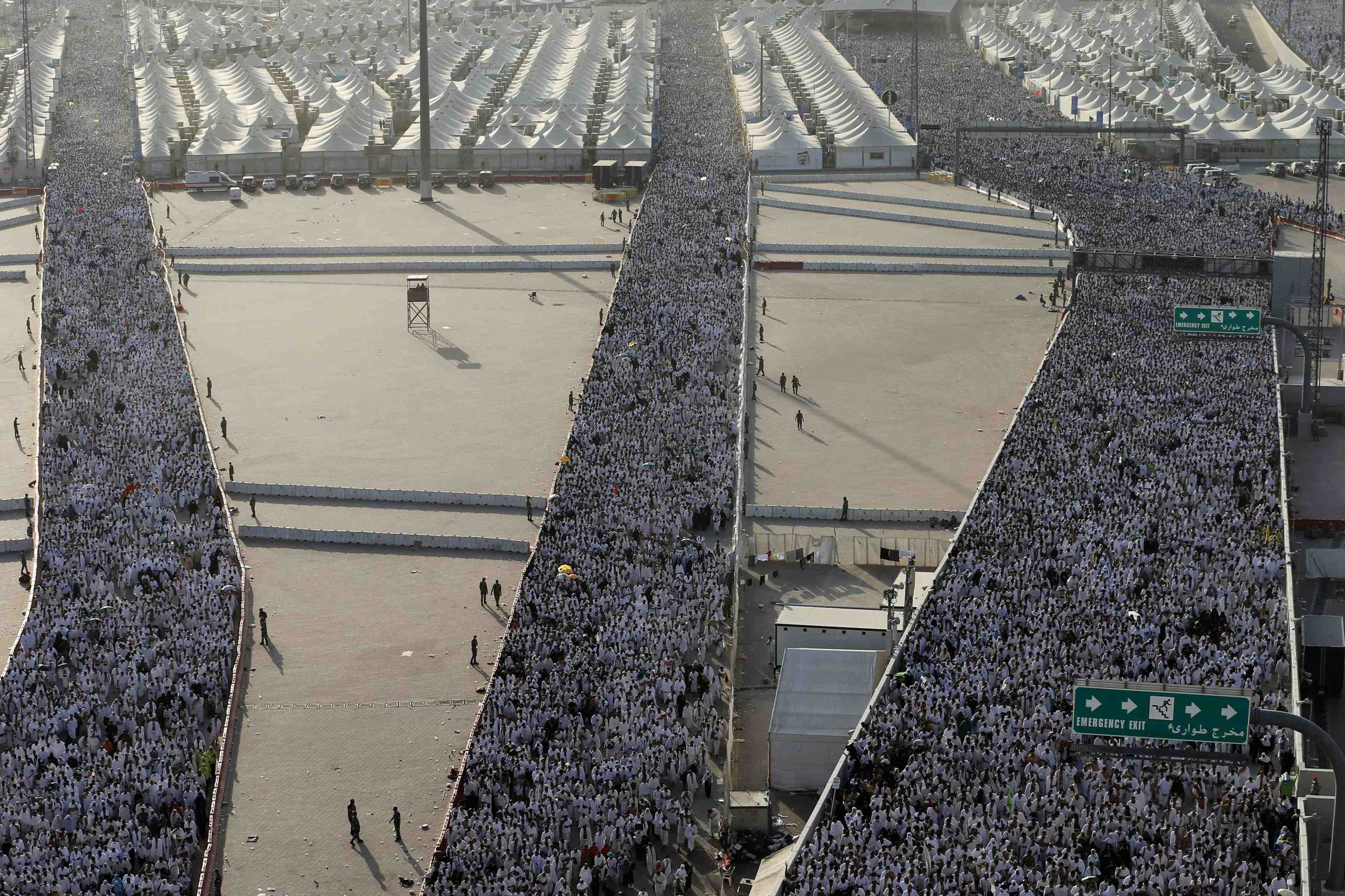 Oct. 4, 2014. Muslim pilgrims arrive to cast stones at pillars symbolizing Satan, during the annual hajj pilgrimage, on the first day of Eid al-Adha in Mina, near the holy city of Mecca.