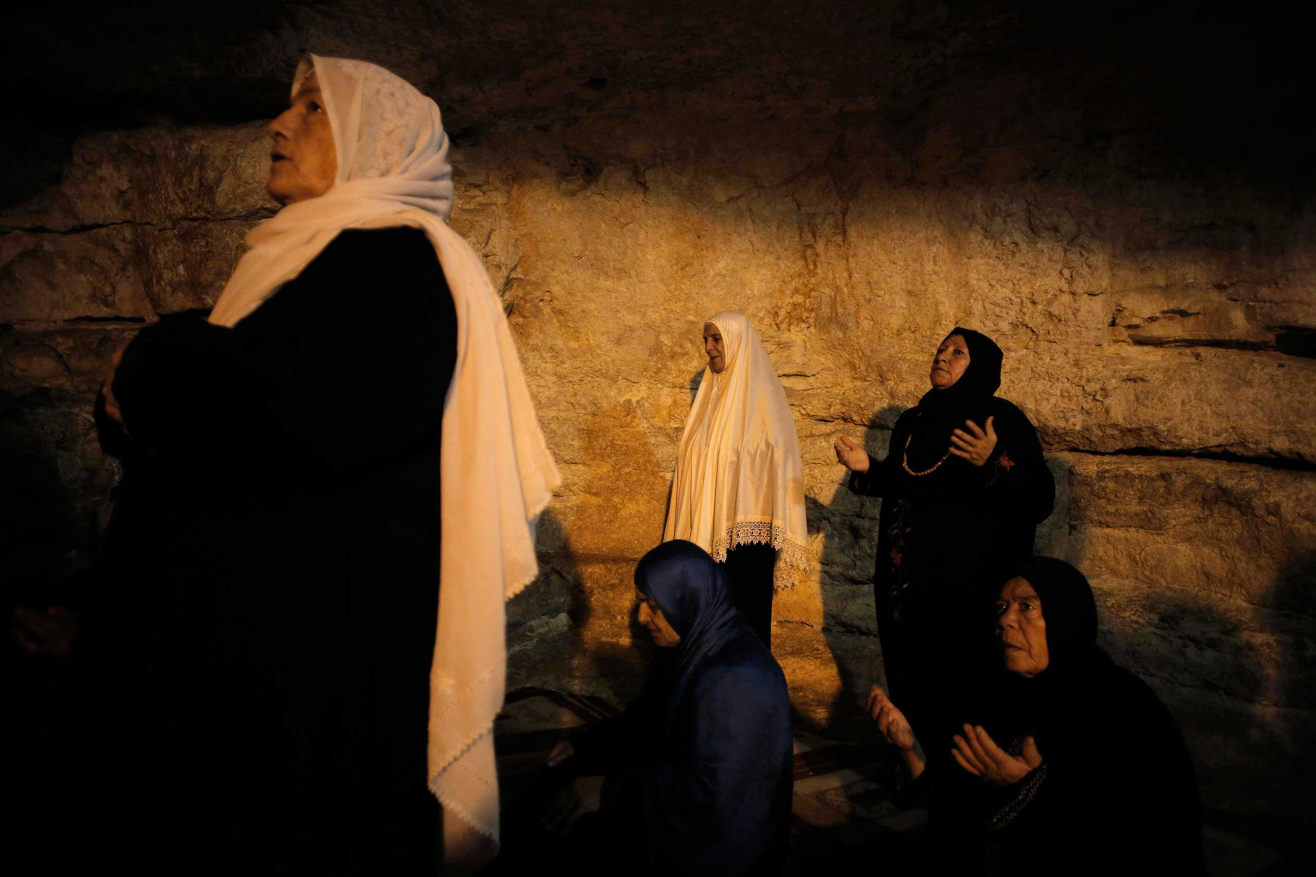 Oct. 5, 2014. Palestinian women from Gaza pray inside the Dome of the Rock during their visit at the compound known to Muslims as Noble Sanctuary and to Jews as Temple Mount in Jerusalem's Old City.