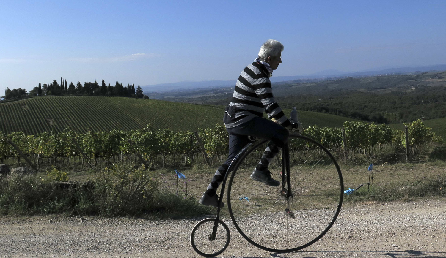 A cyclist rides on a high wheel bicycle to practices a day before the   Eroica  cycling race for old bikes in Tuscany, Italy, Oct. 4, 2014.