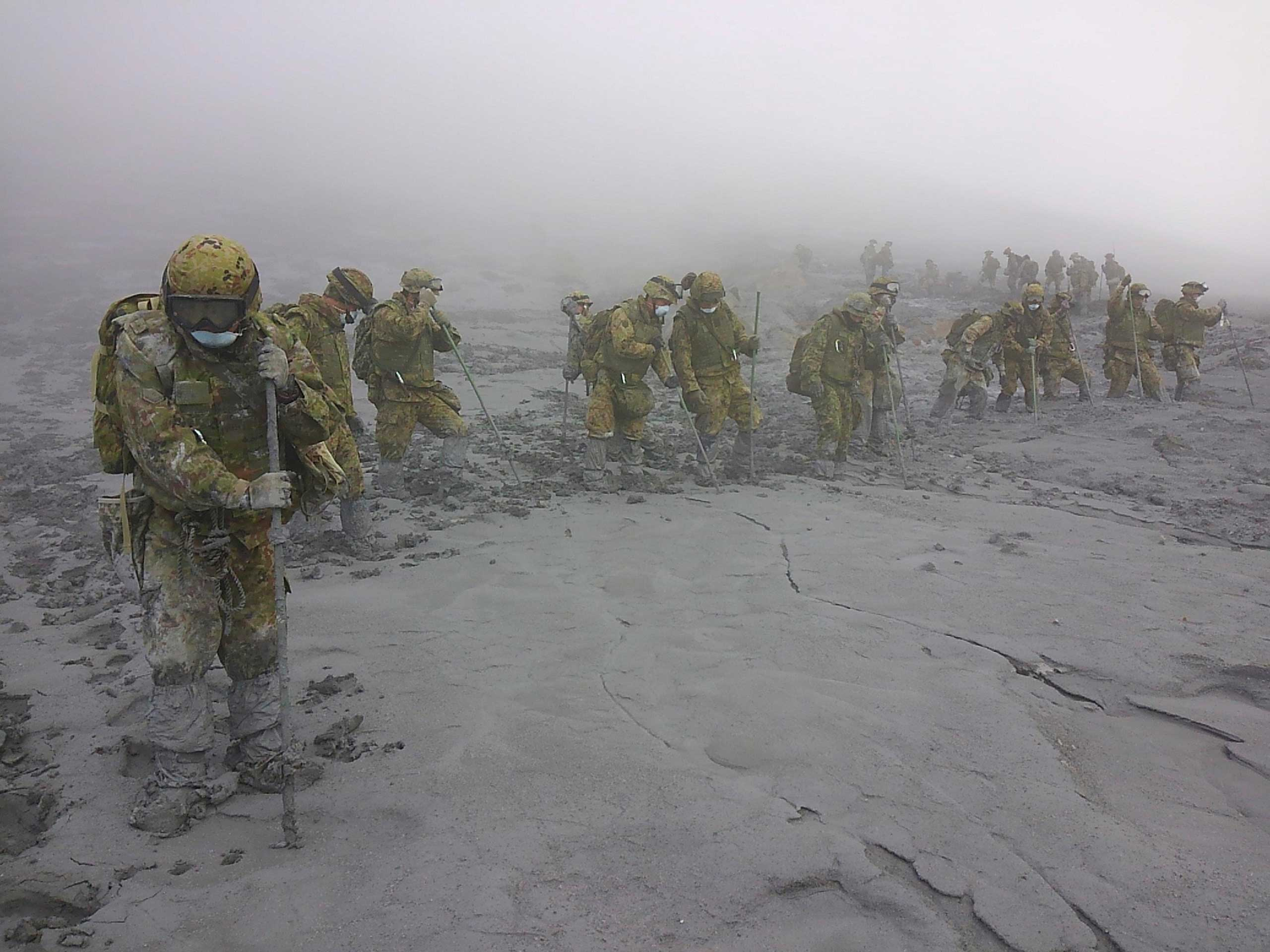 Oct. 7, 2014. Japan Self-Defense Force (JSDF) soldiers conduct rescue operations on Mount Ontake, which erupted September 27, 2014 and straddles Nagano and Gifu prefectures in central Japan.