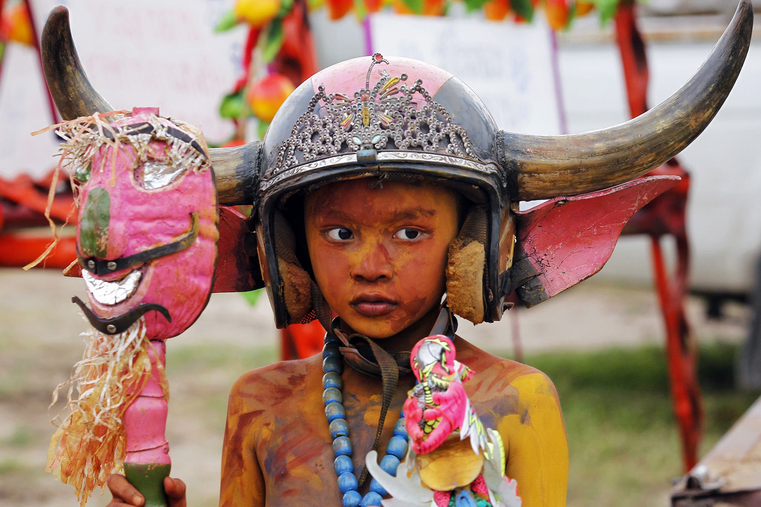 A boy wearing a horned helmet and body paint arrives for Chonburi's annual buffalo race festival, east of Bangkok, Thailand, Oct. 7, 2014.