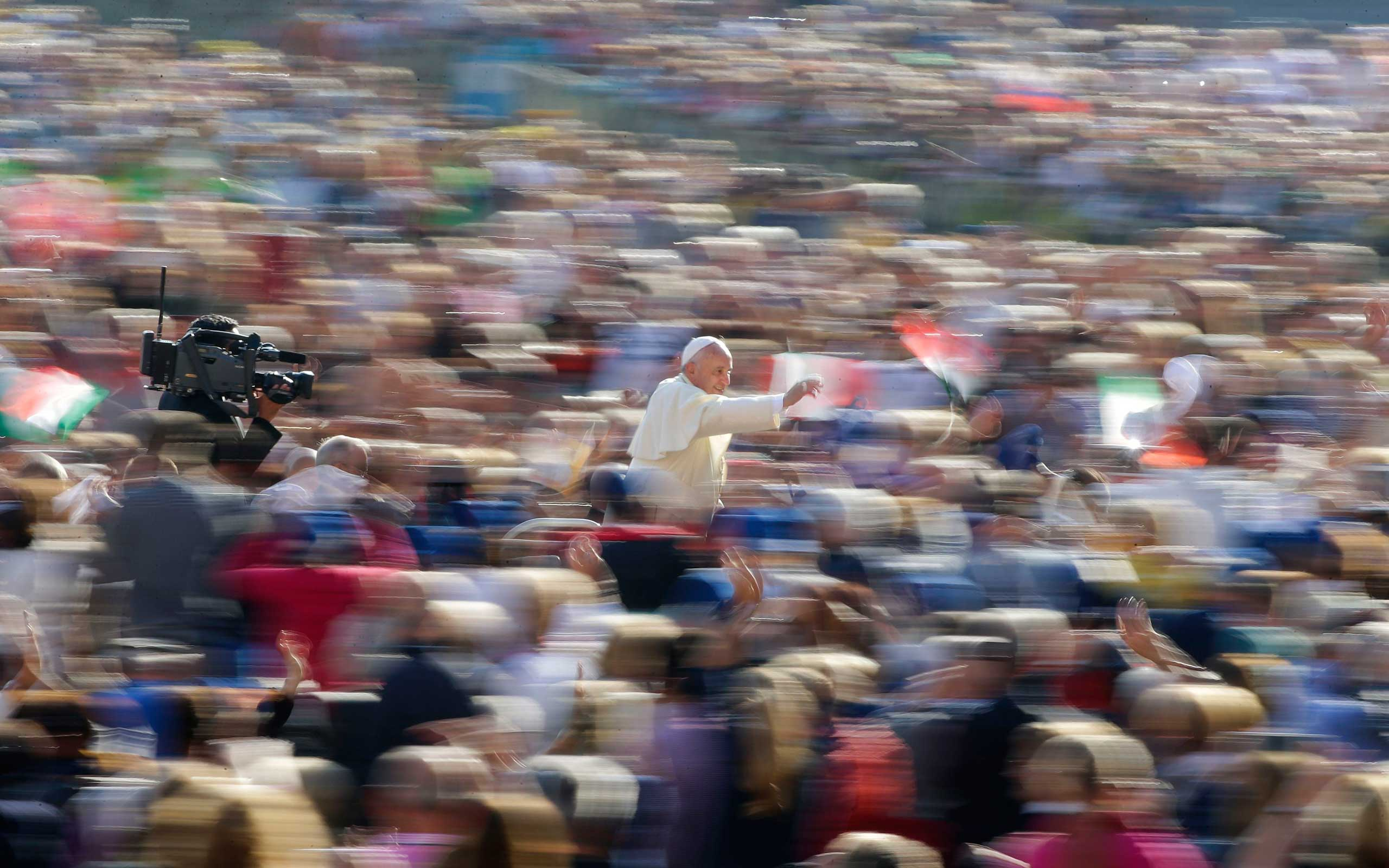 Oct. 8, 2014. Pope Francis waves as he leads his weekly audience in Saint Peter's Square at the Vatican.