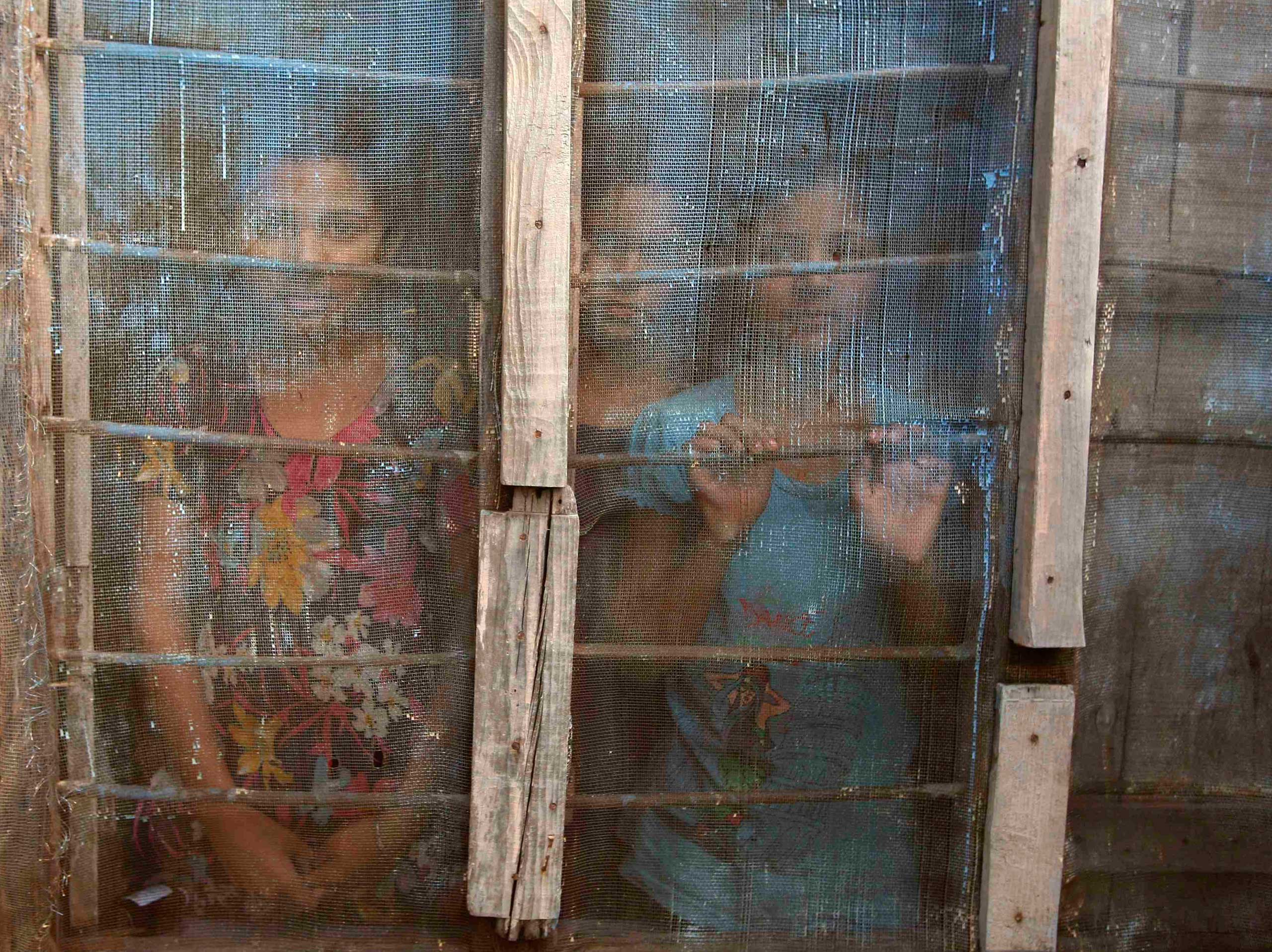 Oct. 8, 2014. Indian village girls look out from a window as they take shelter at a relief camp in Salehar village near Jammu. Five civilians were killed and thousands took refuge in camps in the disputed region of Kashmir on Wednesday after some of the most intense fighting between nuclear-armed neighbors Pakistan and India in a decade.