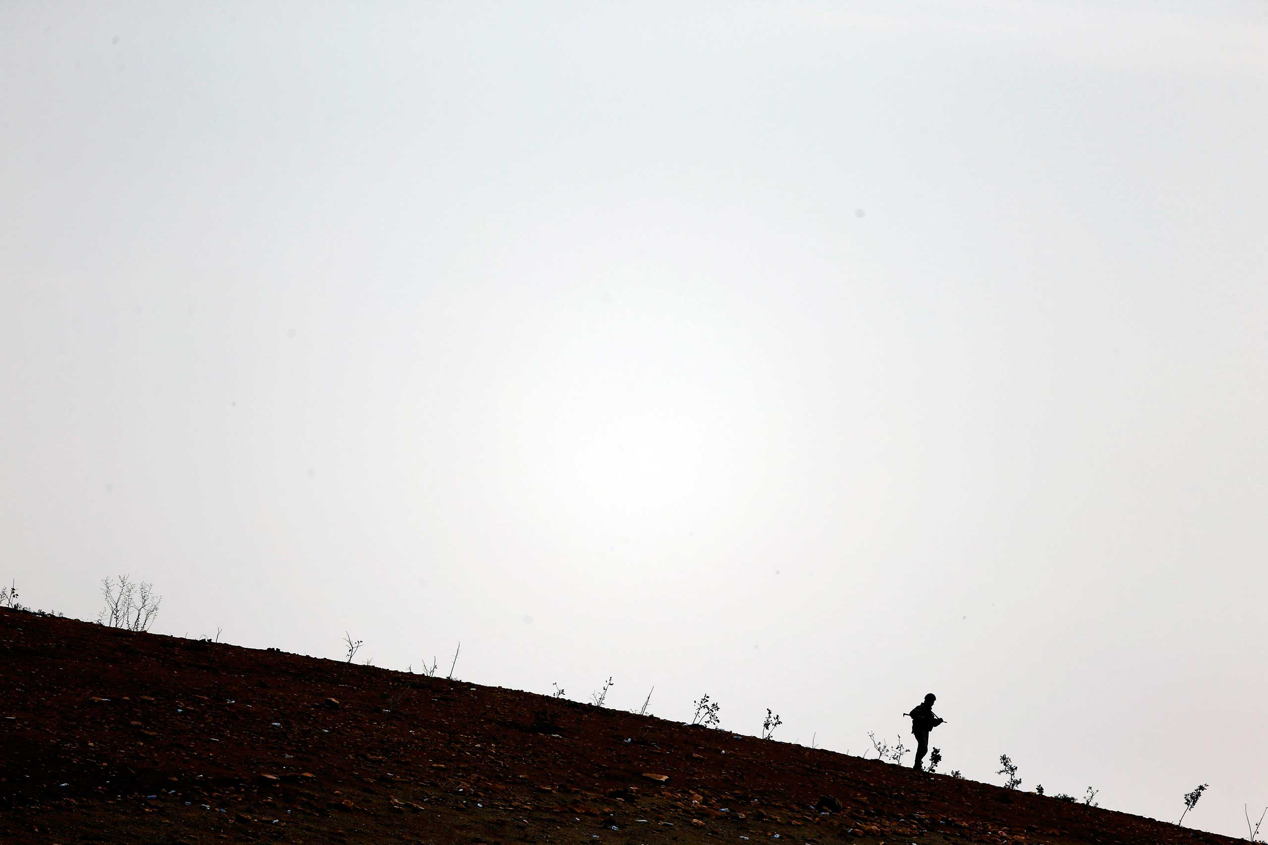 Oct. 17, 2014. A turkish soldier walks near the Mursitpinar border crossing on the Turkish-Syrian border in the southeastern town of Suruc in Sanliurfa province. A U.S. State Department official held direct talks for the first time last weekend with a Syrian Kurdish group involved in the fight against Islamic State in Syria, including the besieged town of Kobani, the State Department said on Thursday.