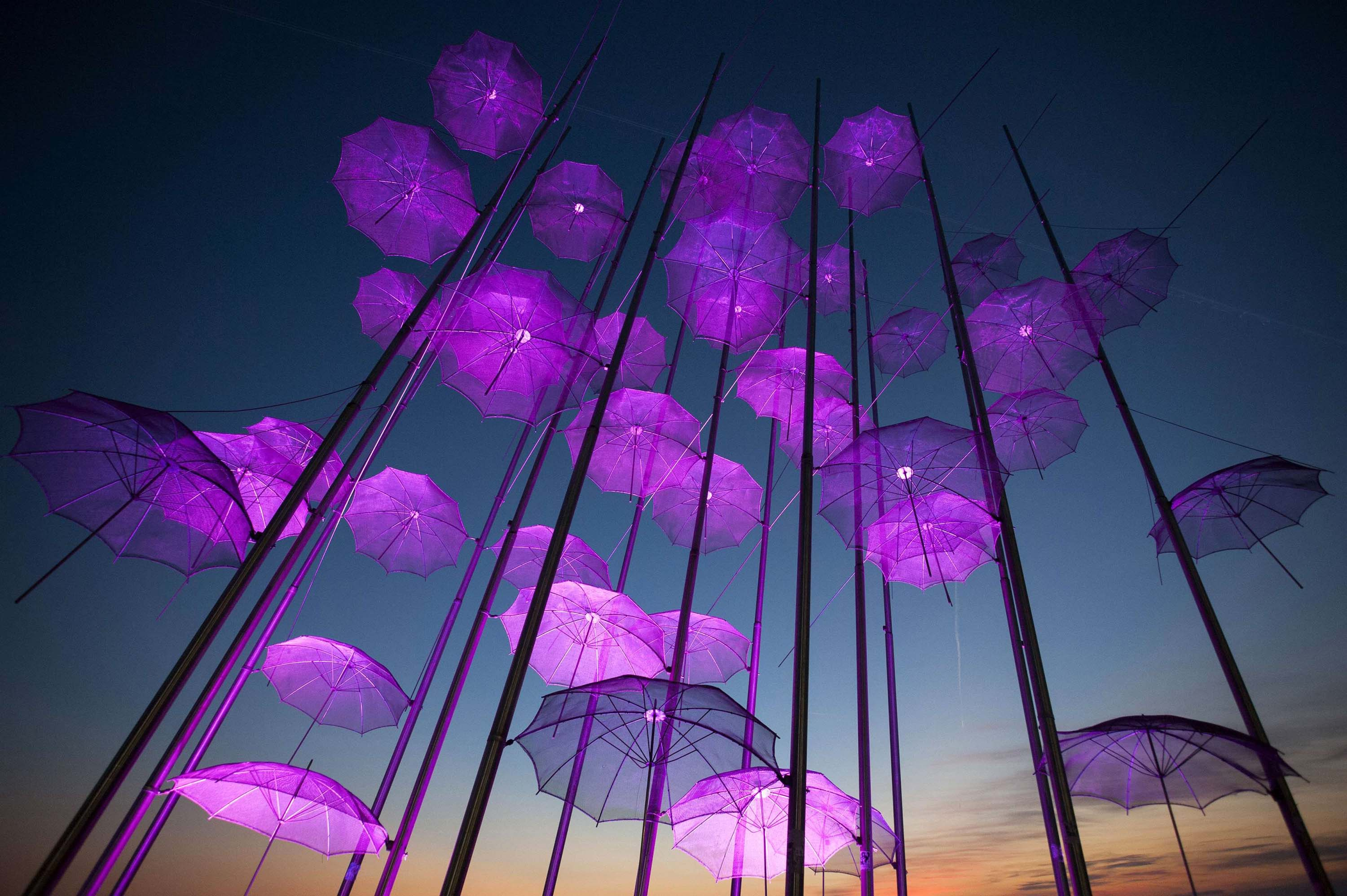 Umbrellas , the sculpture by Giorgos Zogolopoulos is illuminated in pink light to mark Breast Cancer Awareness Month in Thessaloniki in northern Greece on Oct. 21, 2014.