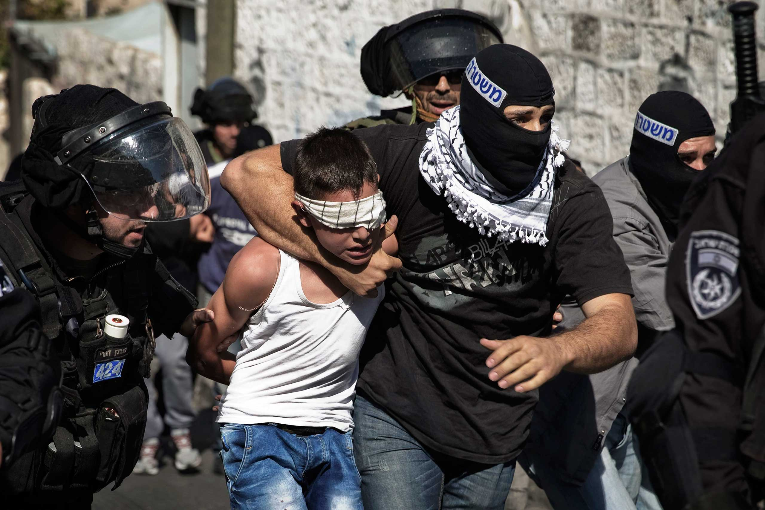 Oct. 24, 2014. Israeli police detain a Palestinian youth following clashes after Friday prayers in the east Jerusalem neighborhood of Wadi al-Joz. Tension in Jerusalem rose on Wednesday after an Israeli baby died and eight other people were hurt when a Palestinian man slammed his car into pedestrians at a Jerusalem light railway stop.