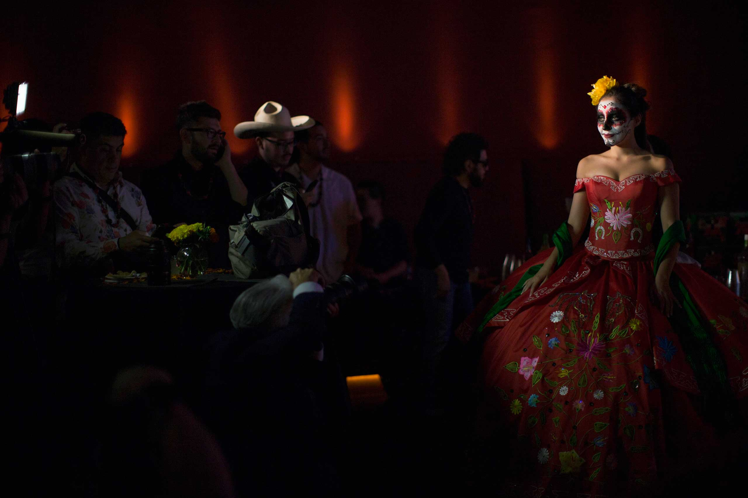 Oct. 24, 2014. A model is pictured during a Quinceañera Magazine Catrina fashion show at a press reception ahead of the 15th annual Day of the Dead festival at Hollywood Forever Cemetery in Los Angeles.