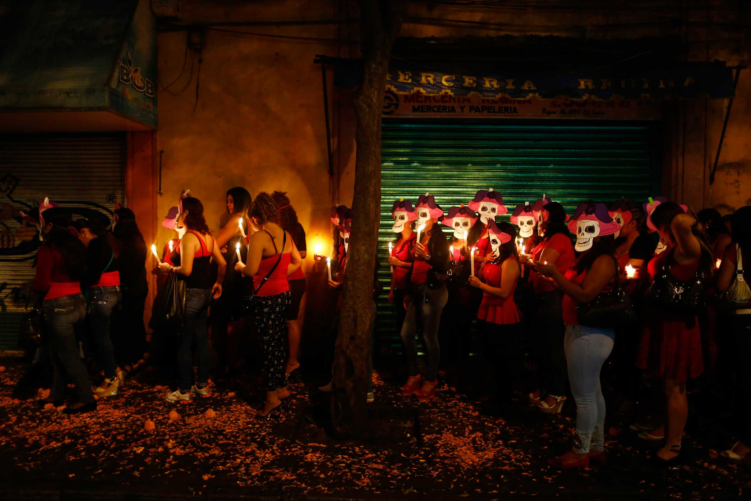 Sex workers wear skeleton masks, a traditional Mexican symbol representing the Day of the Dead, during a procession to remember their deceased colleagues, especially those who were violently murdered, in Mexico City on Oct. 27, 2014.