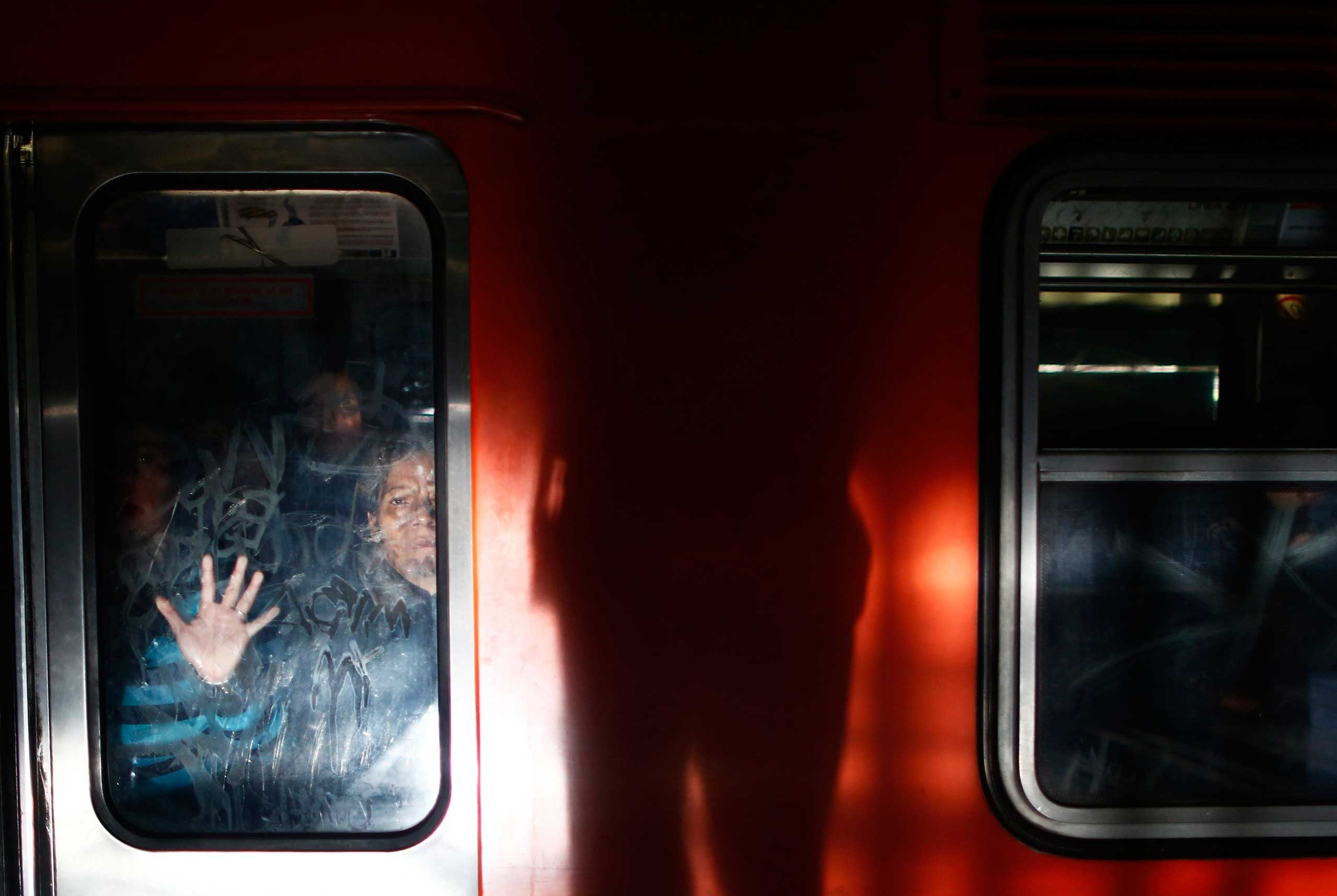 Oct. 24, 2014. Women ride the women-only passenger car at a subway station in Mexico City. Trains, buses and taxis for women only are on the rise in cities globally.